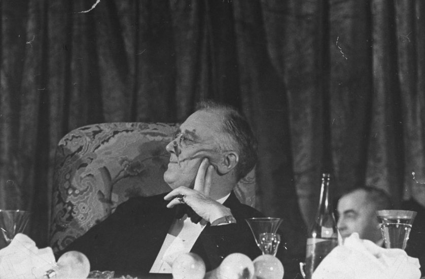 President Franklin Roosevelt listens to a speech during the annual Jackson Day fundraising dinner in Washington, DC. Originally published in the January 24, 1938, issue of LIFE.