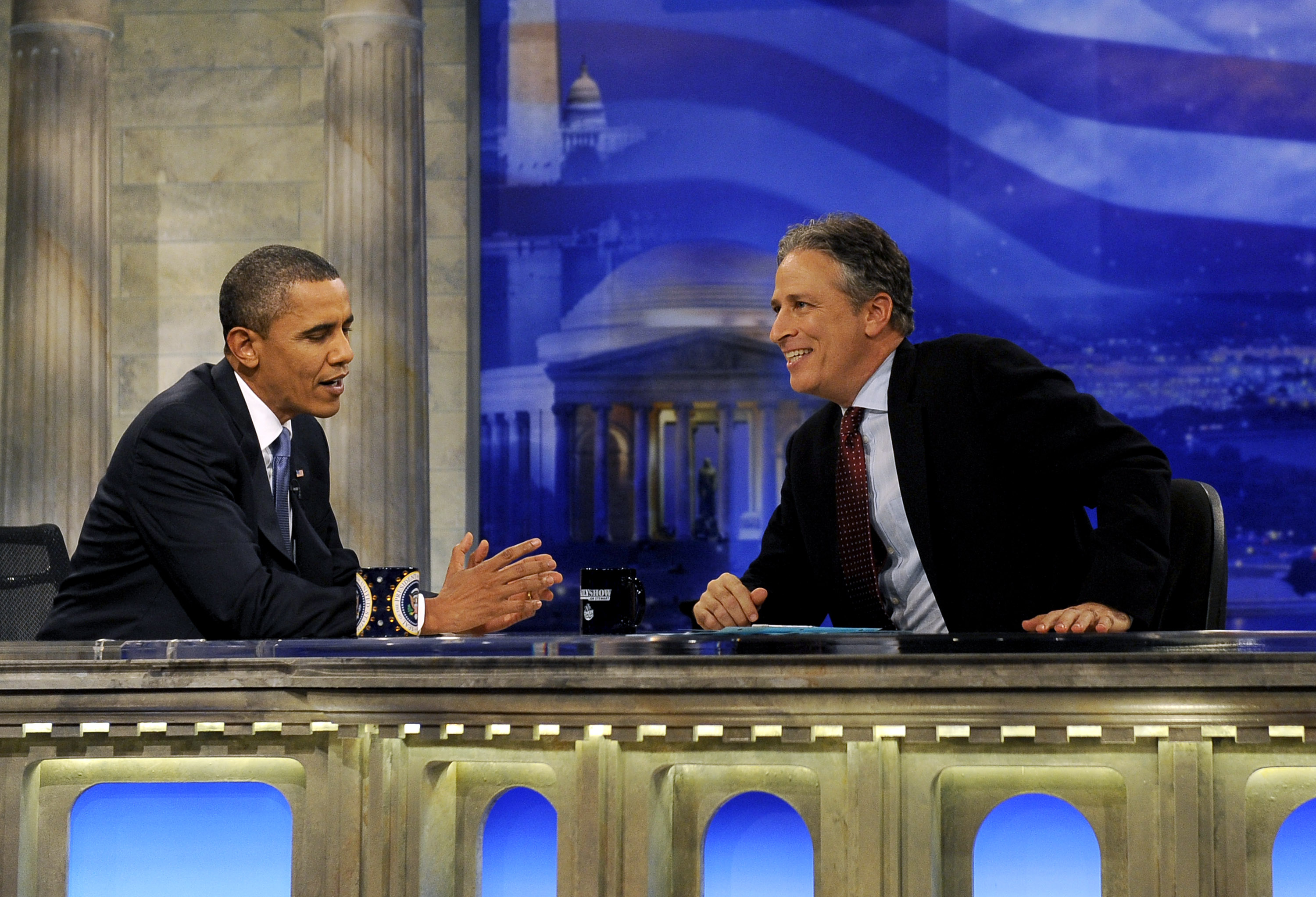 President Barack Obama chats with Daily Show host Jon Stewart during a commercial break in taping on October 27, 2010 in Washington, D.C.