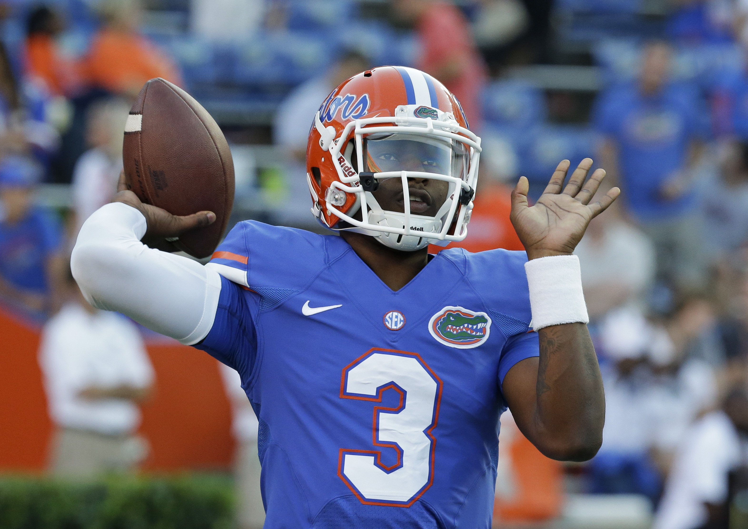 Florida quarterback Treon Harris warms up prior to an NCAA college football game against Missouri in Gainesville, Fla. on Oct. 18, 2014.