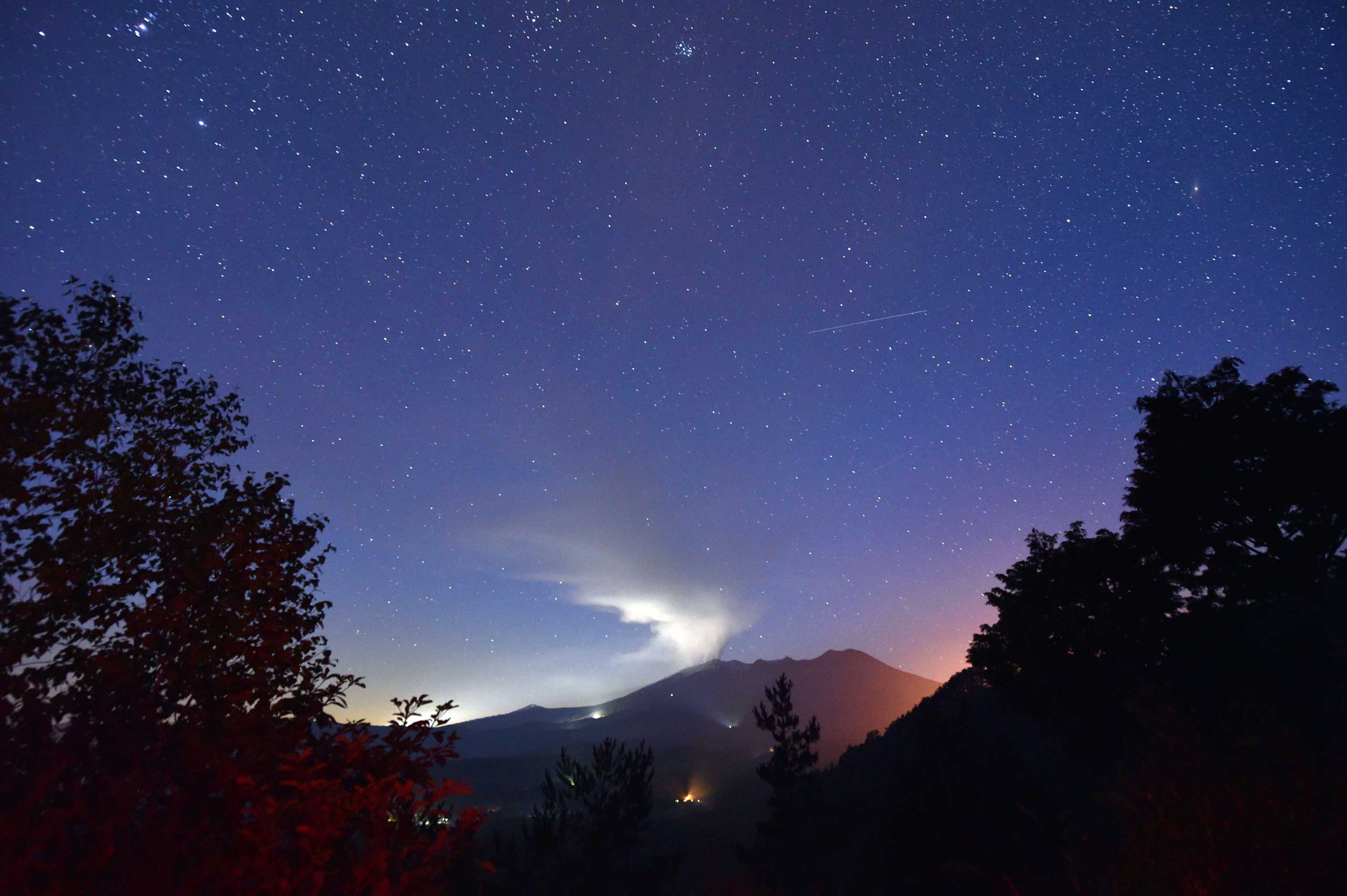 Sept. 28, 2014.                                This picture shows a smoke rising from Mount Ontake in Nagano prefecture. The volcano erupted in central Japan on September 27, shooting ash and rocks into the air that reportedly left eight hikers injured and forced 150 people to shelter in cabins near the summit.