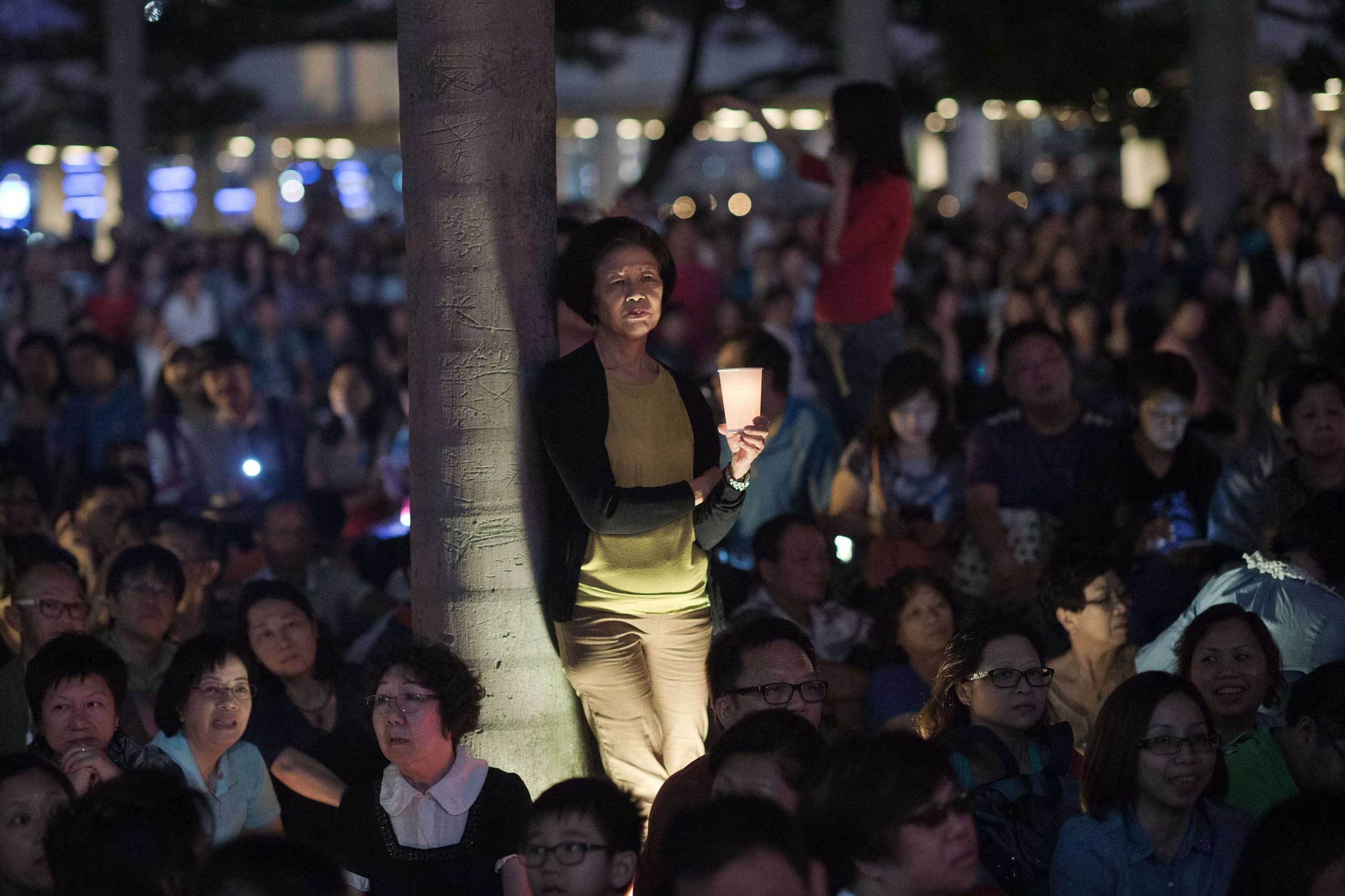 Oct. 25, 2014.                                Members of the pro-government Blue Ribbon group rally during a candlelit vigil in Hong Kong. A U.N. rights watchdog pressed Hong Kong to enact democratic reforms, saying moves so far fell short of what was needed.