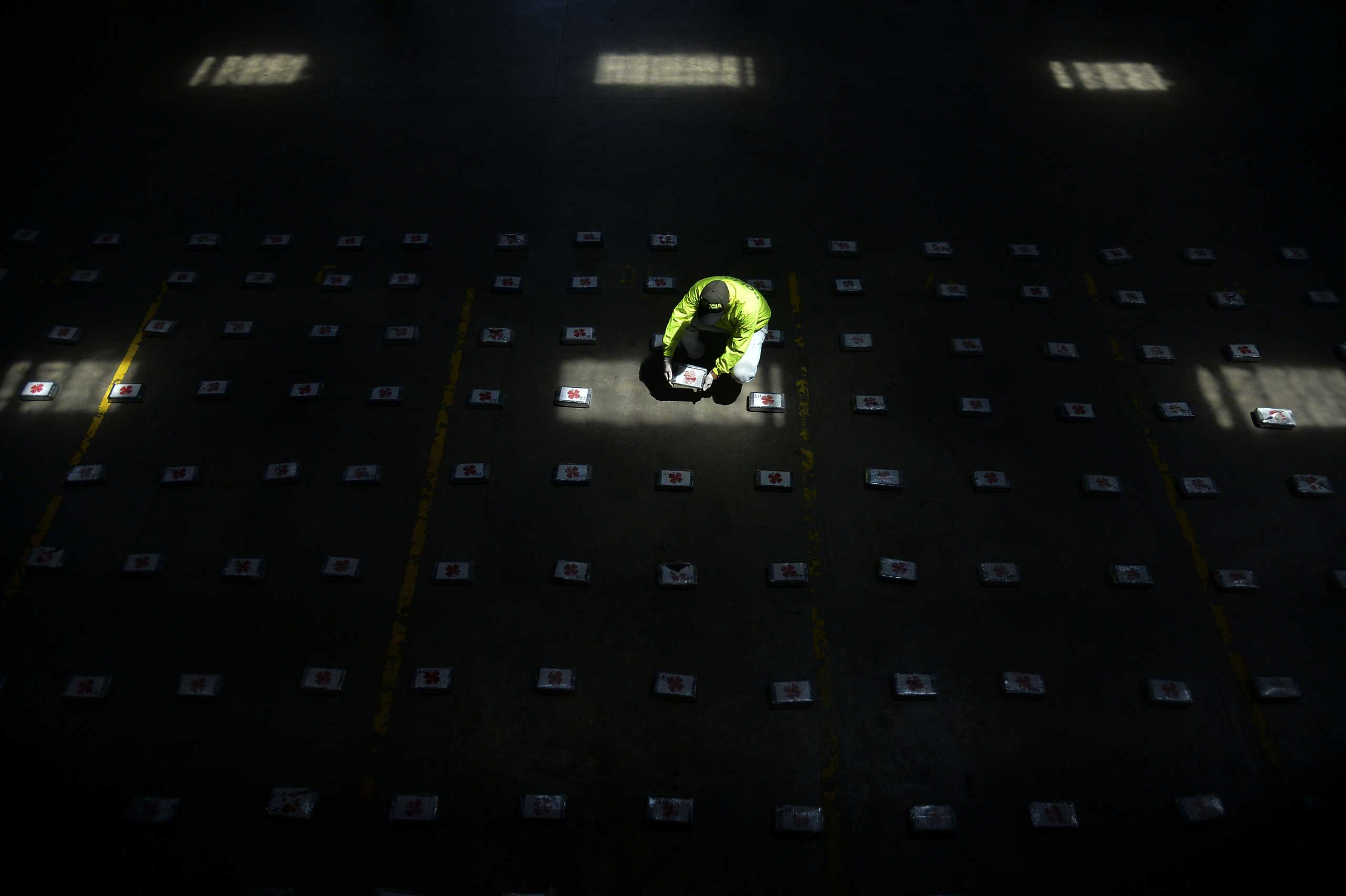 Sept. 27, 2014.                               A Colombian police officer sets up packages of cocaine to be shown to the press in Medellin, Antioquia department, Colombia. The anti-narcotics unit of the National Police seized a half-ton of cocaine during an operation called  Republic 69 .