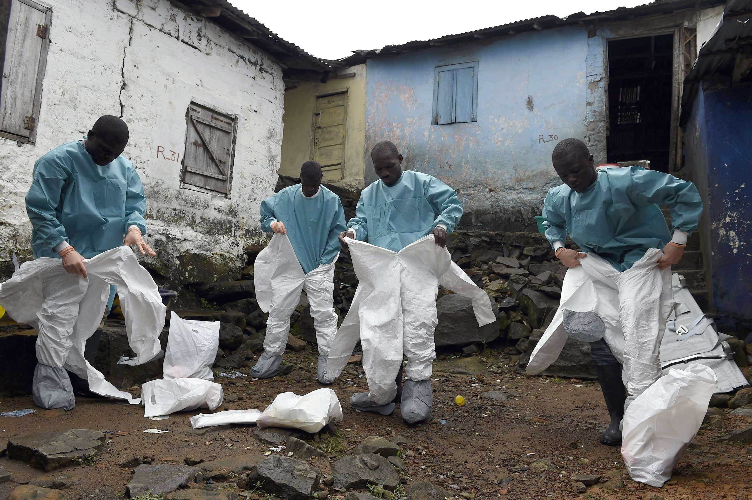 Sept. 29, 2014. Medical staff members of the Croix Rouge NGO put on protective suits before collecting the corpse of a victim of Ebola, in Monrovia. Of the four west African nations affected by the Ebola outbreak, Liberia has been hit the hardest, with 3,458 people infected -- more than half of the total number of cases. Of those, 1,830 have died, according to a WHO count released on September 27.