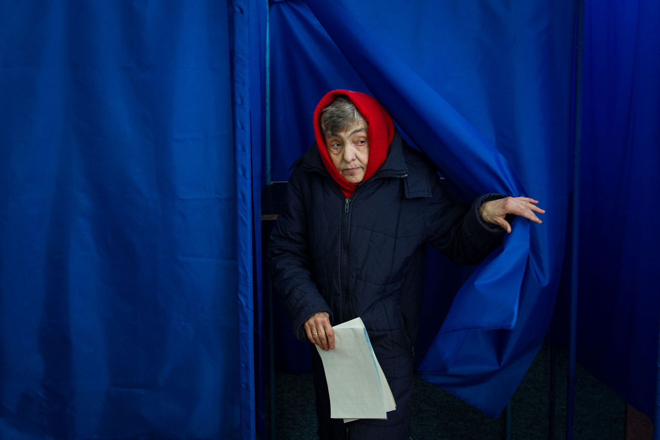 A woman leaves a polling booth as she votes during the parliamentary elections in Kiev, Ukraine, on Oct. 26, 2014
