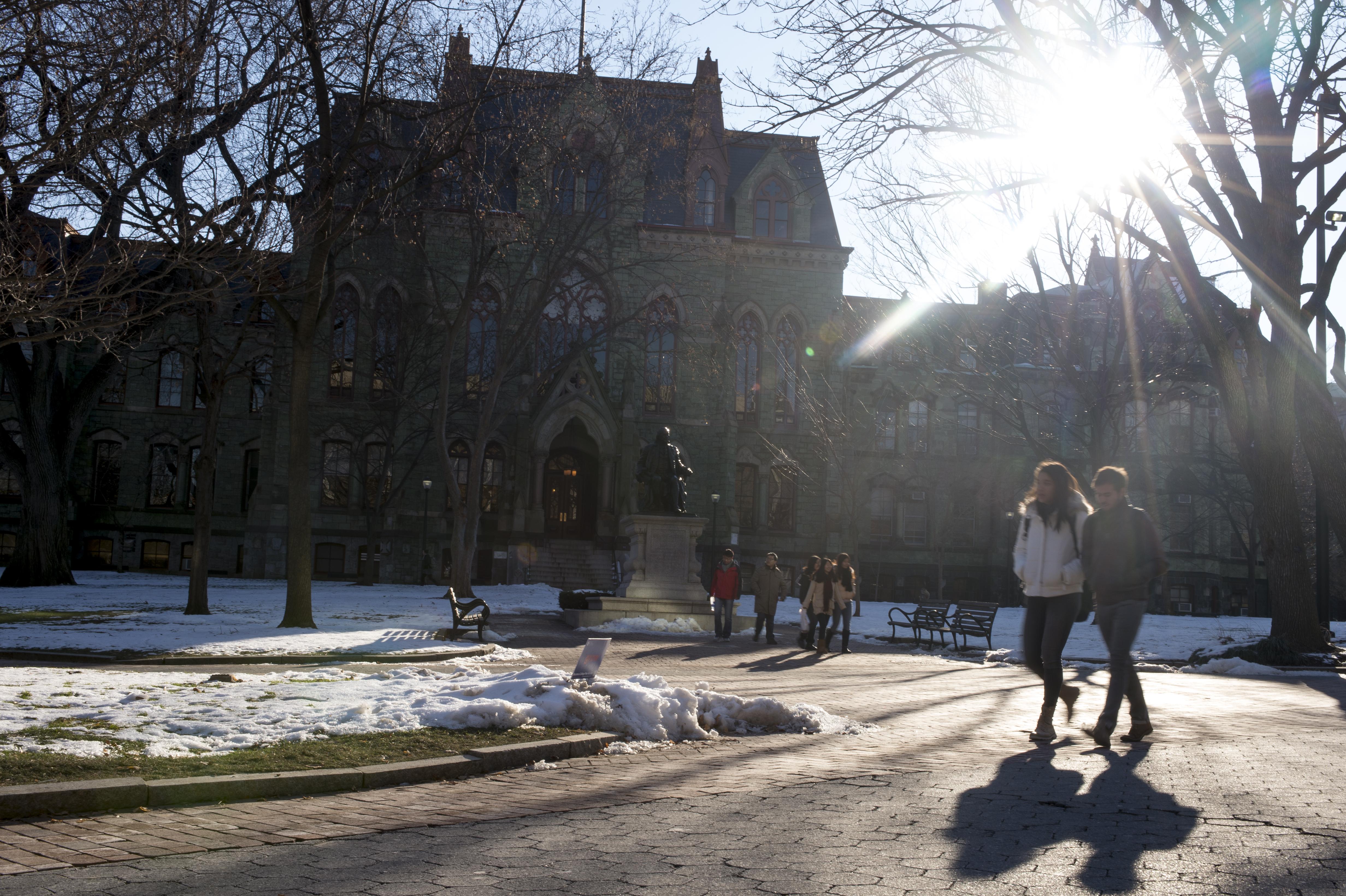 Students walk through the University of Pennsylvania campus on December 16, 2013 in Philadelphia, Pennsylvania.