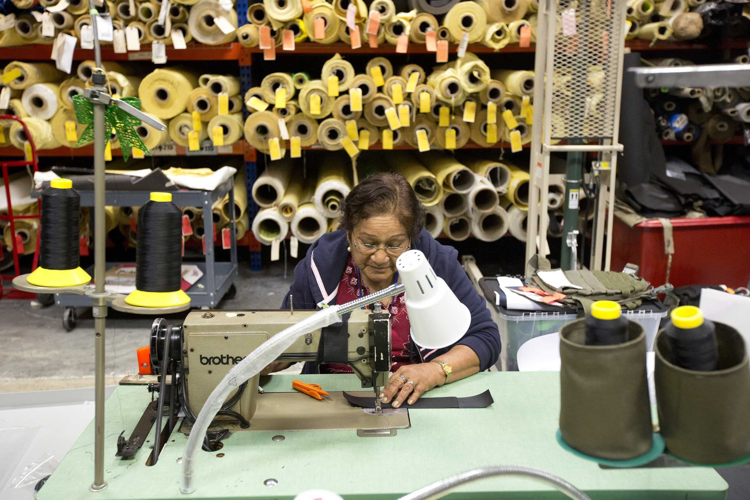Rosa Pantoja sews a bullet proof vest together in the Research and Development department of the Point Blank Body Armor factory in Pompano Beach, Fla., Sept. 19, 2014