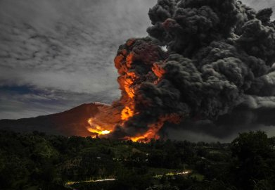 Mount Sinabung volcano erupts, as seen from Tiga Pancur village, Karo Regency in Indonesia's North Sumatra province on Oct. 8, 2014.