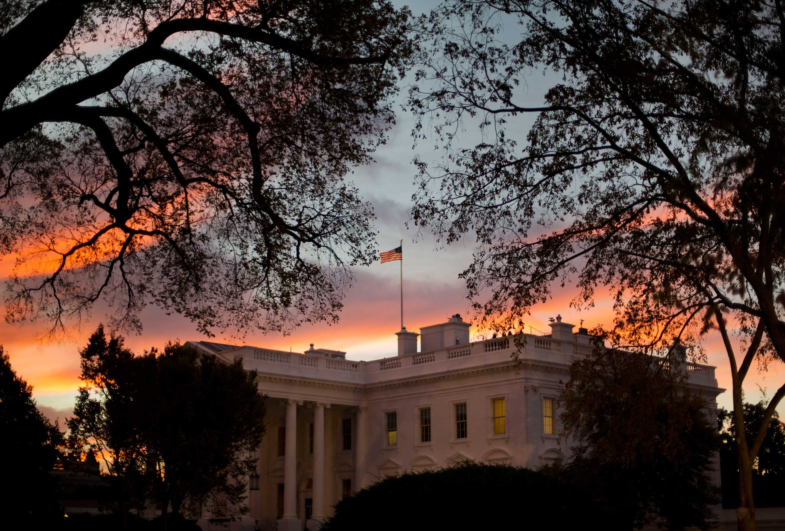 Early morning sunrise is seen over the White House in Washington, Oct. 28, 2014.