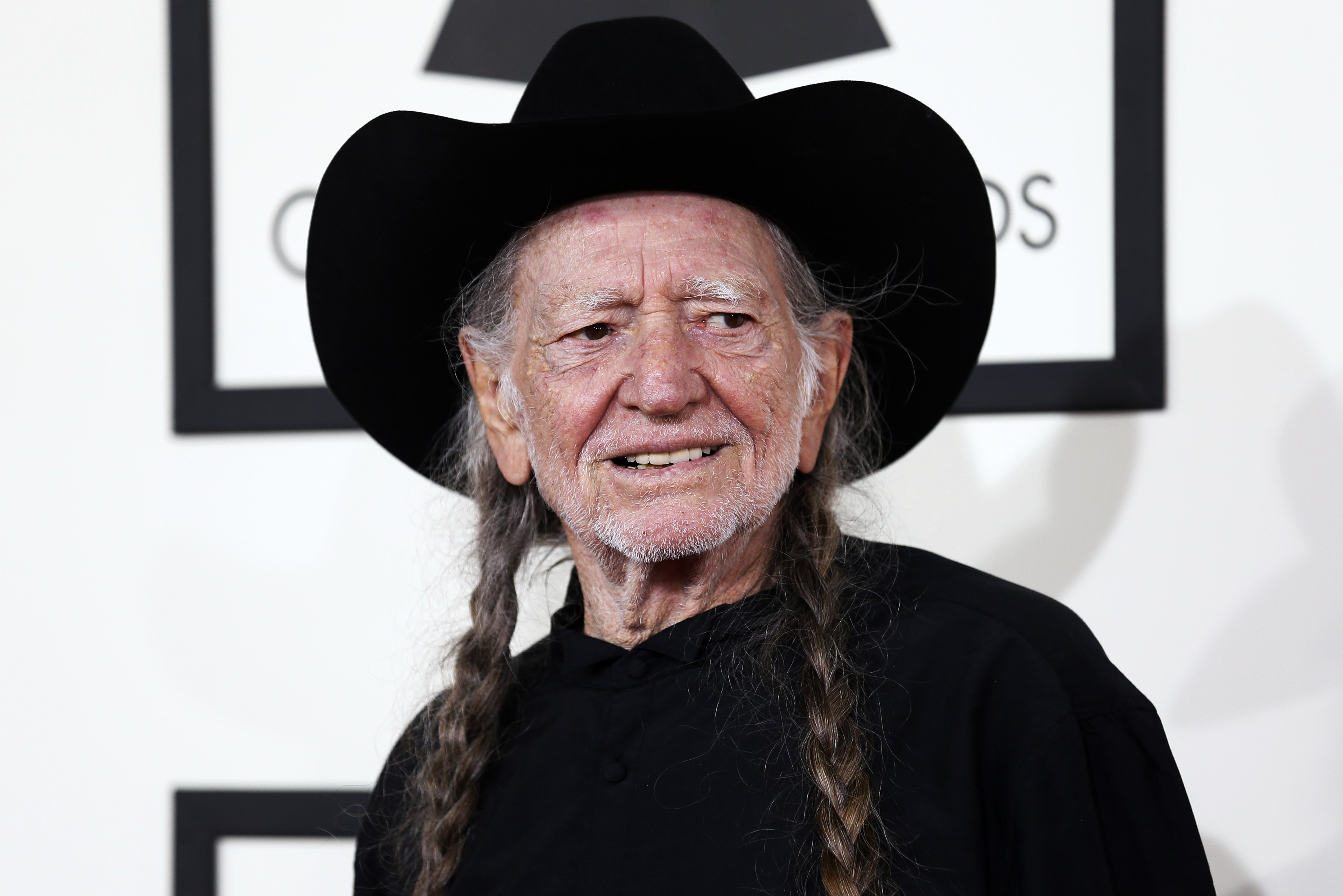 Musician Willie Nelson arrives at the 56th annual Grammy Awards in Los Angeles on Jan. 26, 2014