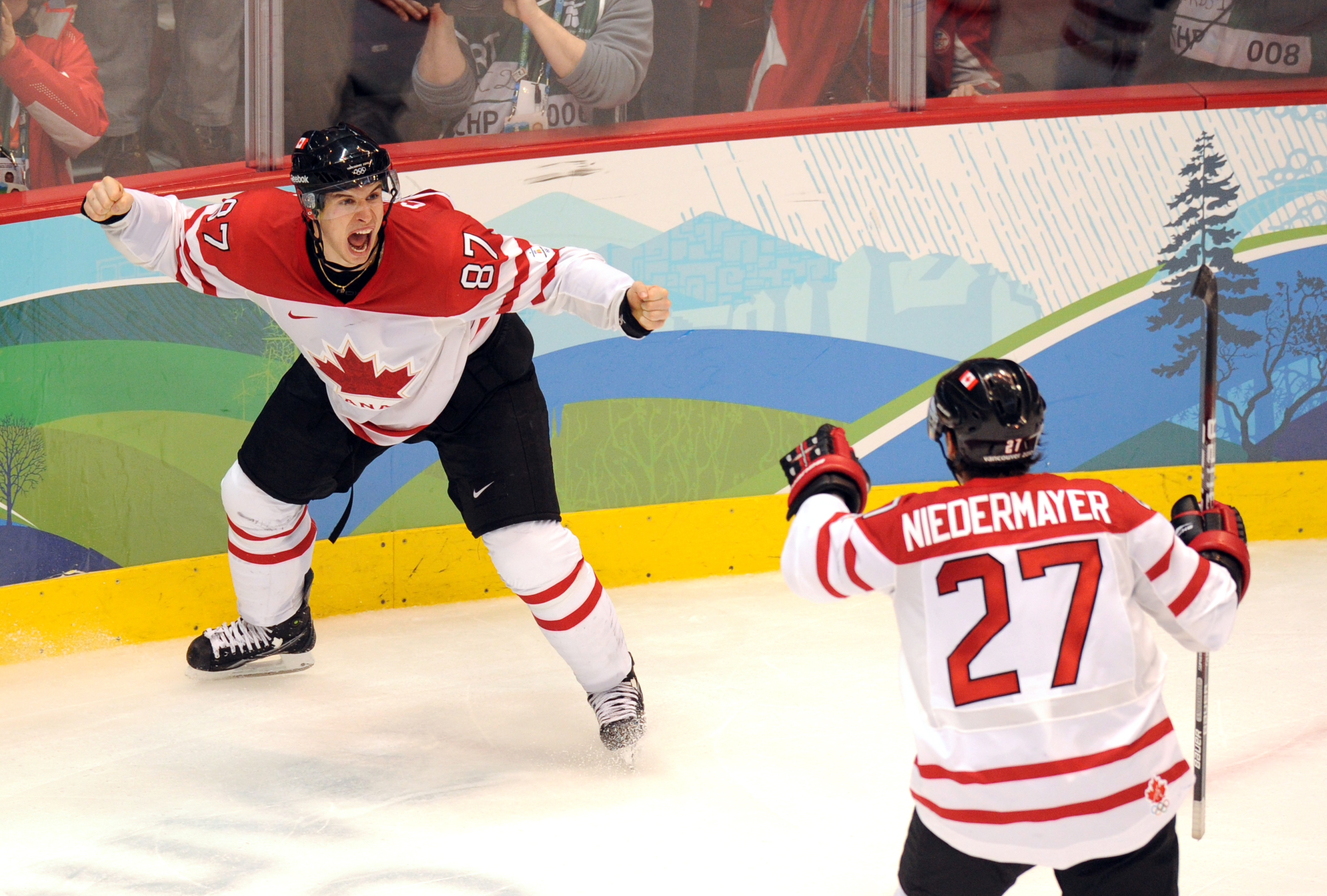 Canadian forward Sidney Crosby (87) and Canadian defenseman Scott Niedermayer (27) jubilate as their team wins gold against the USA in the Men's Gold Medal Hockey match at the Canada Hockey Place during the XXI Winter Olympic Games in Vancouver, Canada on February 28, 2010.