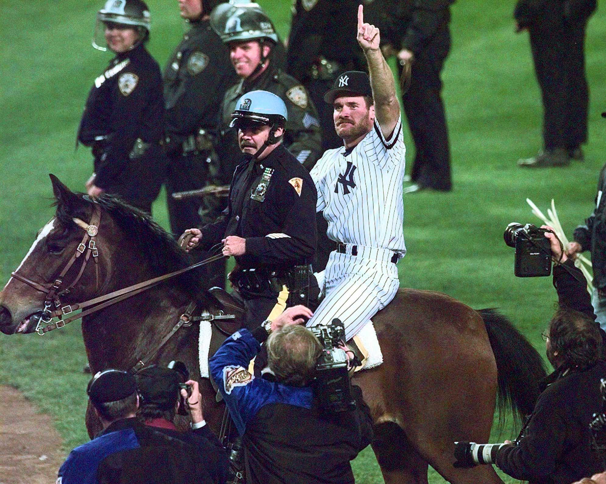 New York Yankees Wade Boggs rides a police horse around the field after the Yankees defeated the Atlanta Braves 3-2 in  Game 6 of the World Series to win the Series  at Yankee Stadium in New York, Saturday, Oct. 26, 1996.
