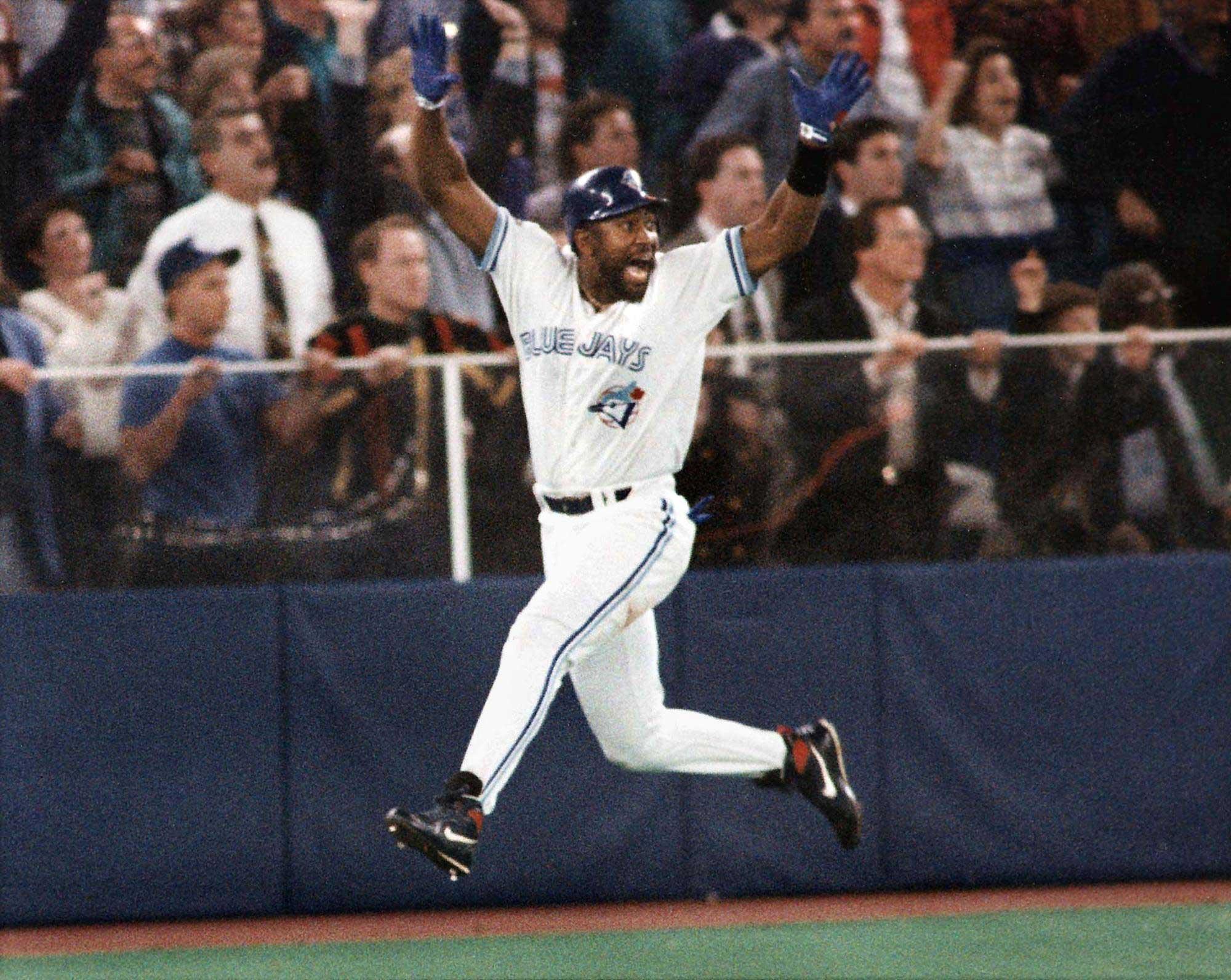 Toronto Blue Jays' Joe Carter celebrates his game winning three-run homerun in the ninth inning of game 6 of the World Series in Toronto, on Oct. 23, 1993.