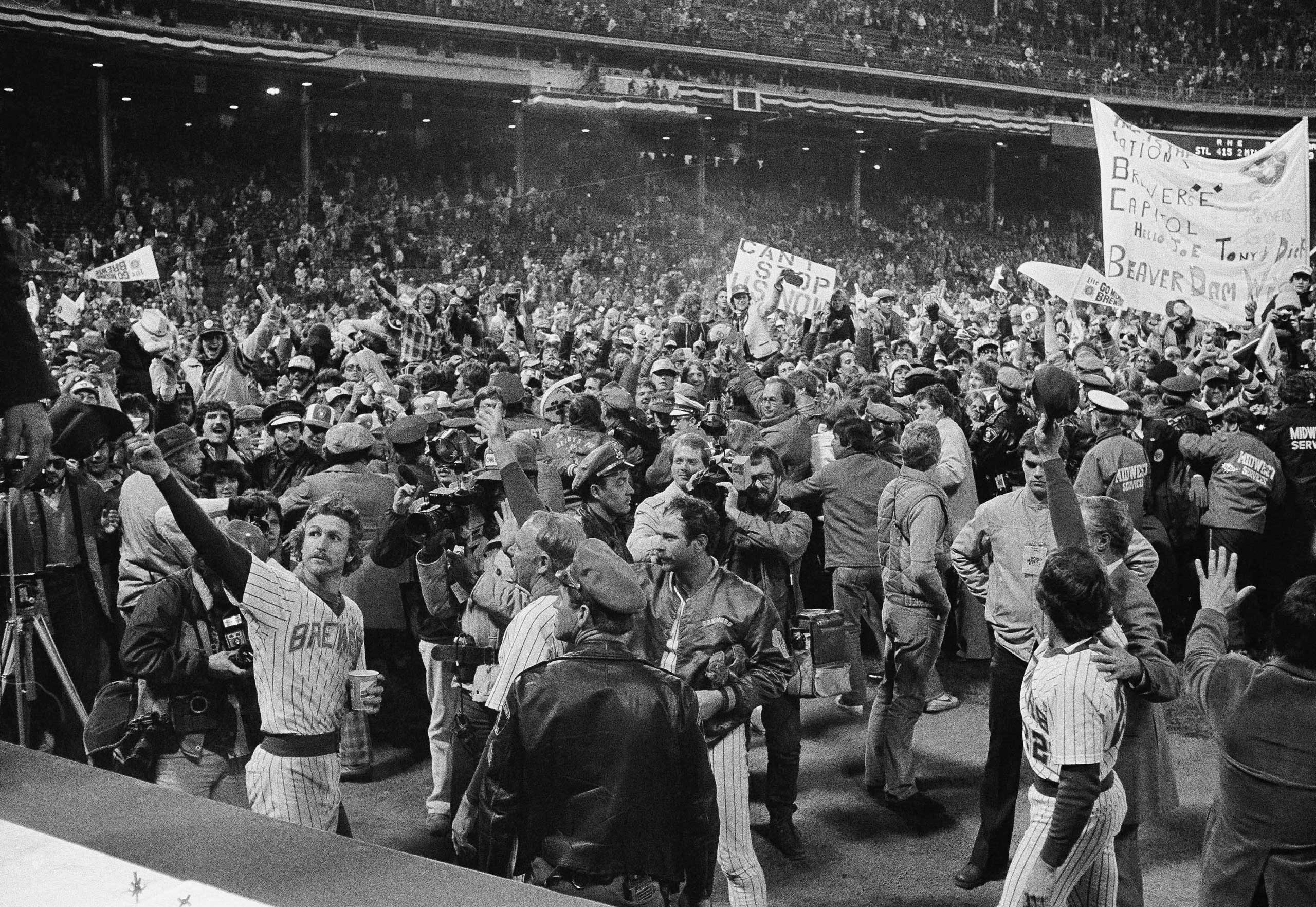 Milwaukee Brewers shortstop Robin Yount, left, waves to the crowd as they celebrate near the dugout in County Stadium after a World Series game, Sunday, Oct. 17, 1982, Milwaukee, Wi.