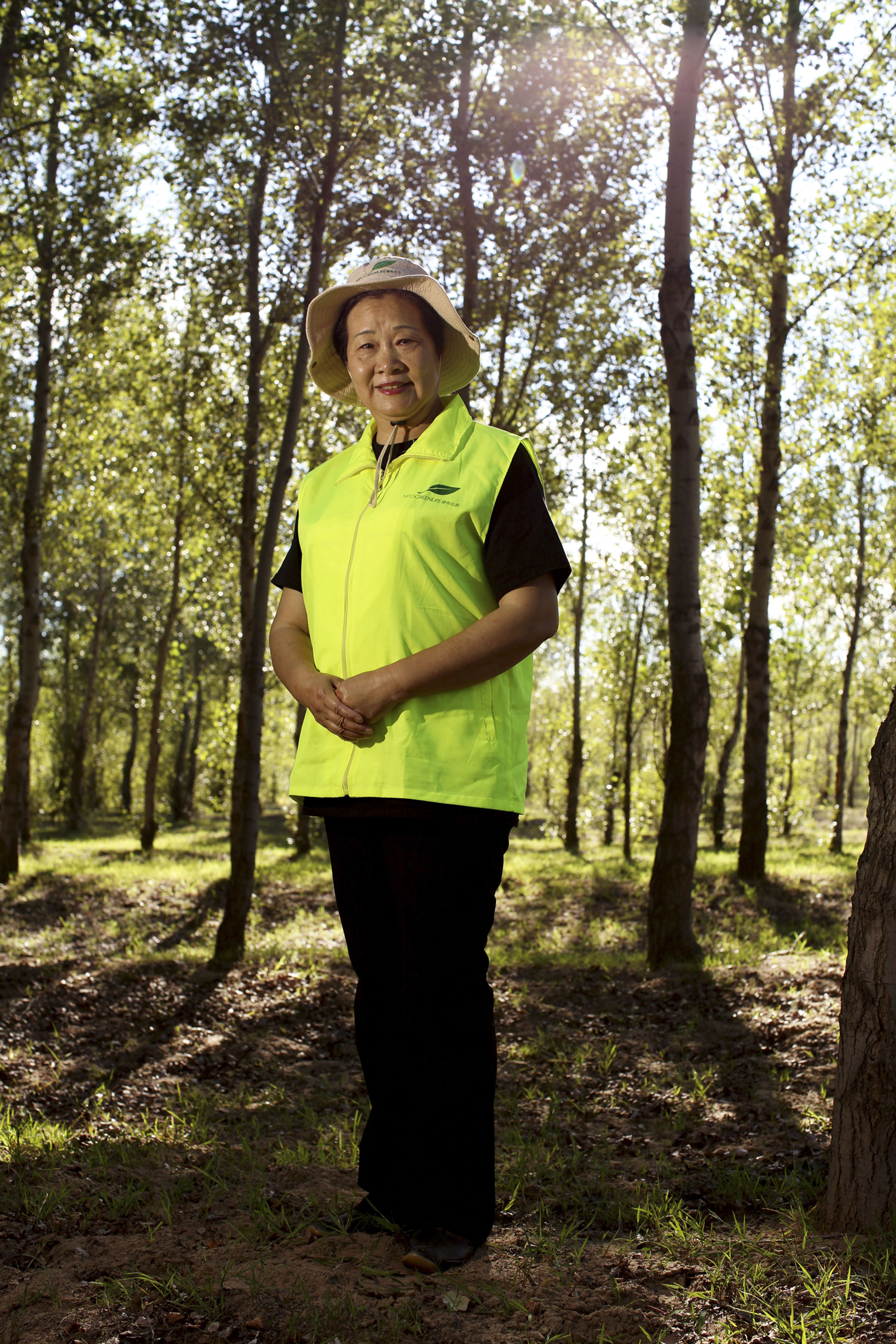 Since 2001, Yi and her Green Life NGO have planted countless numbers of trees