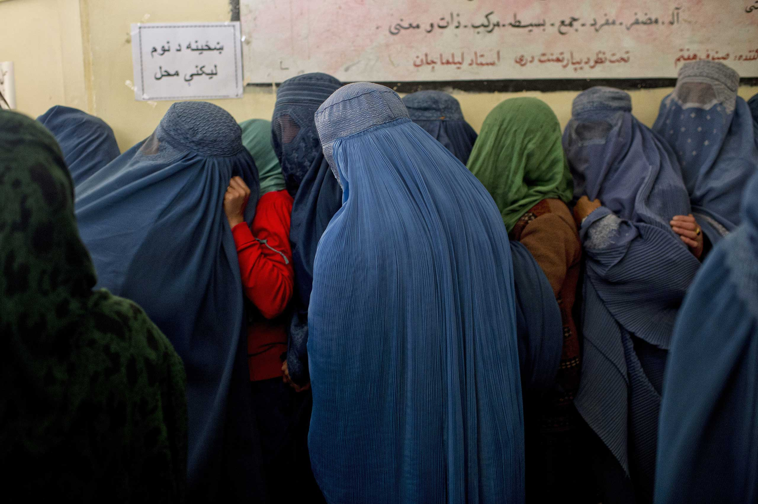 March 25, 2014. Afghans line up for voter registration in Kabul. That morning, a deadly Taliban attack occurred at a nearby election-commission office.From  And Women Shall Lead: Lynsey Addario on the New Face of Afghanistan