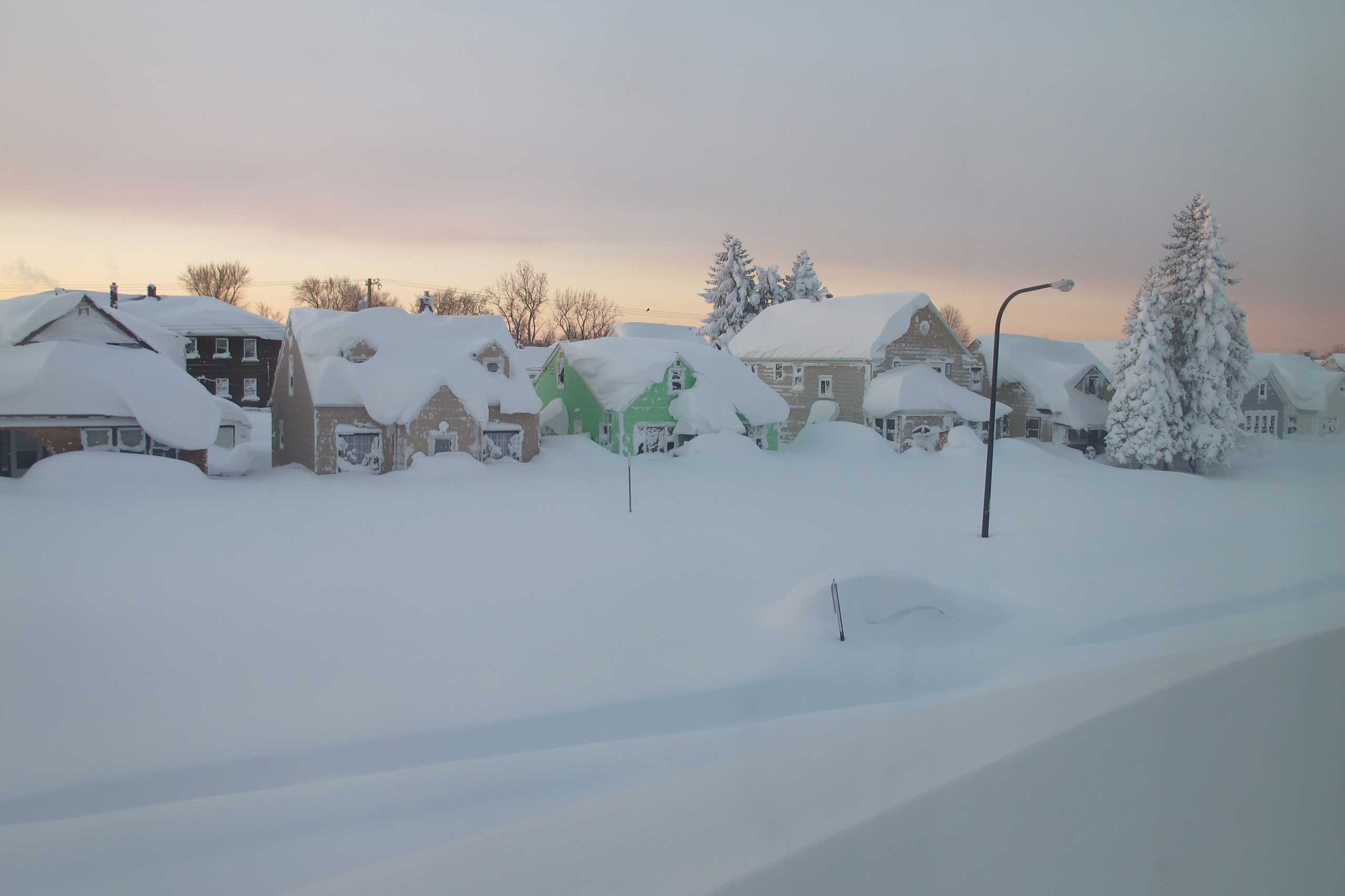 Nov. 19, 2014. Snow covers a street at daybreak in south Buffalo, N.Y. The snowstorm has buried sections of western New York in more than 5 ft. of snow, killing 12 people.