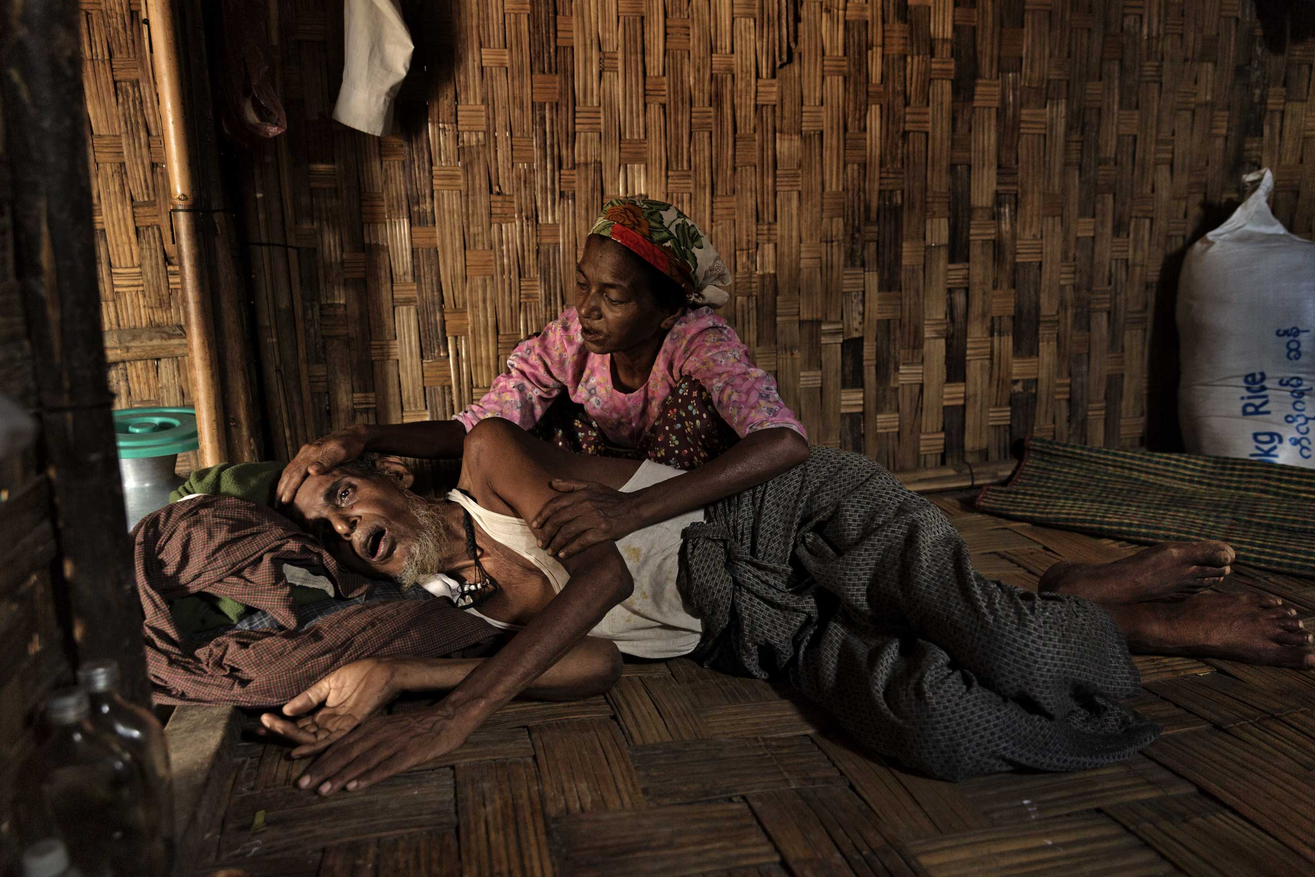 Abdul Kadir, 65, who has a severe stomach ailment and malnutrition, is cared for by his wife in one of the camps. More than 140,000 minority Rohingya Muslims have been forced to live in camps, where disease and despair have taken root.From  The Rohingya, Burma's Forgotten Muslims by James Nachtwey