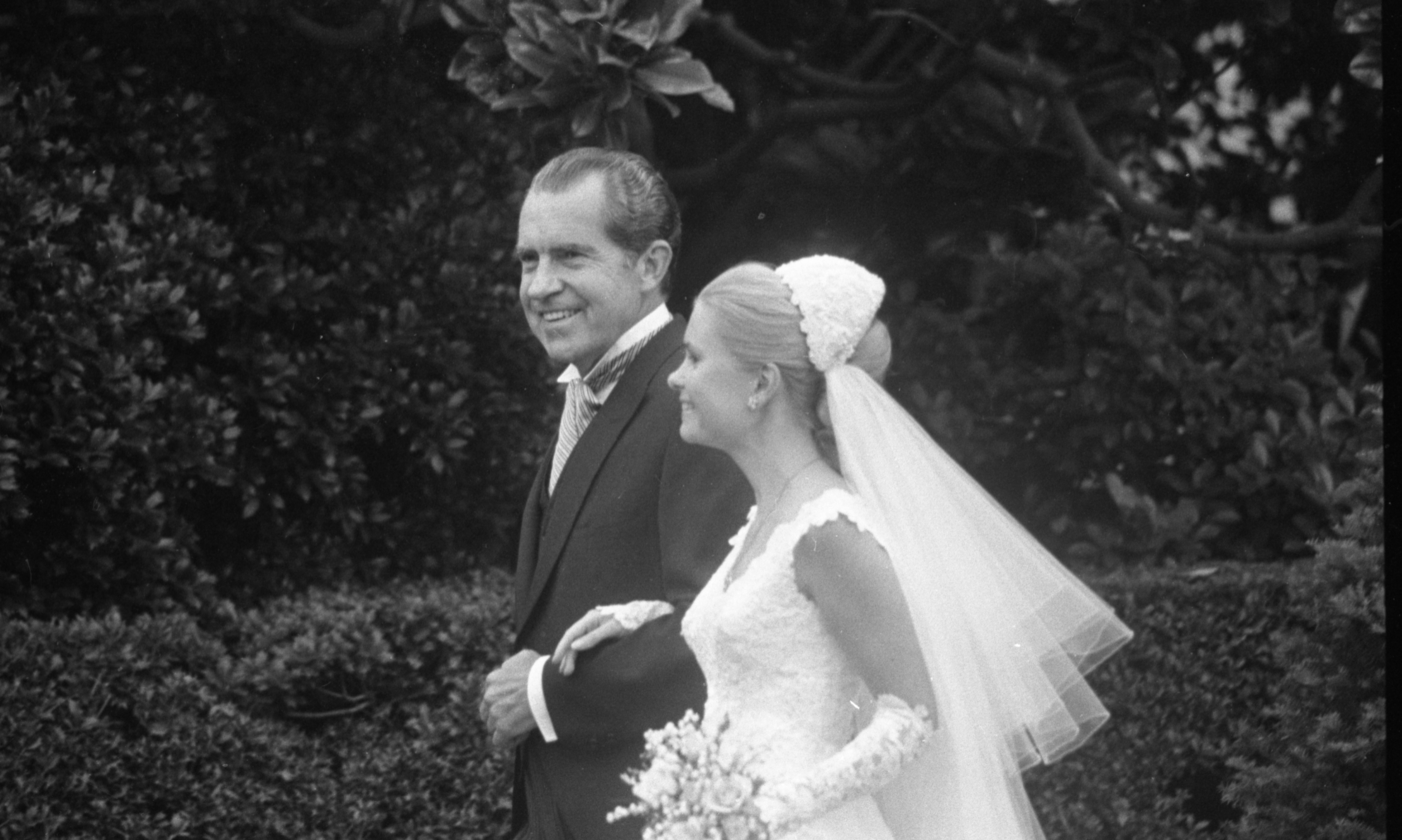 Tricia Nixon on her way to the Rose Garden with her father, President Richard Nixon, at her White House wedding.