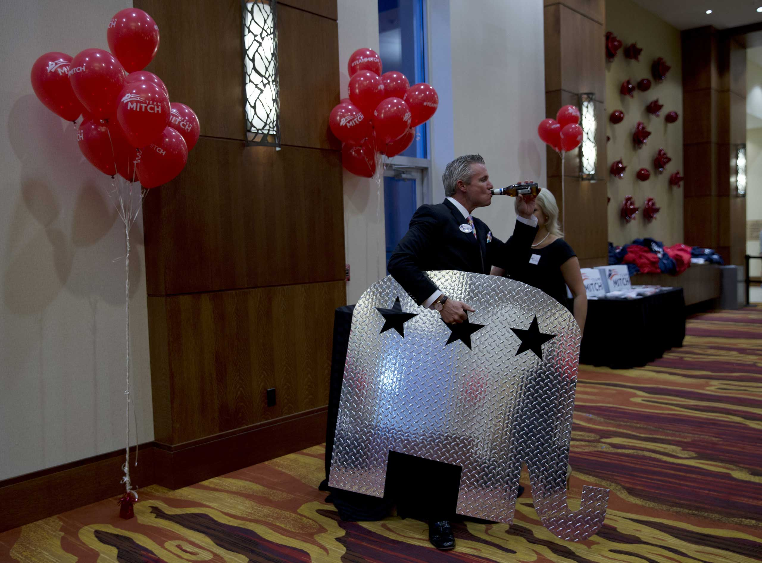 Nov. 4, 2014. Winning campaign Supporters gather at a hotel in Louisville, Ky., to celebrate Mitch McConnell's victory. From  GOP Wave: How Mitch McConnell Won the Day.  November 17, 2014 issue.