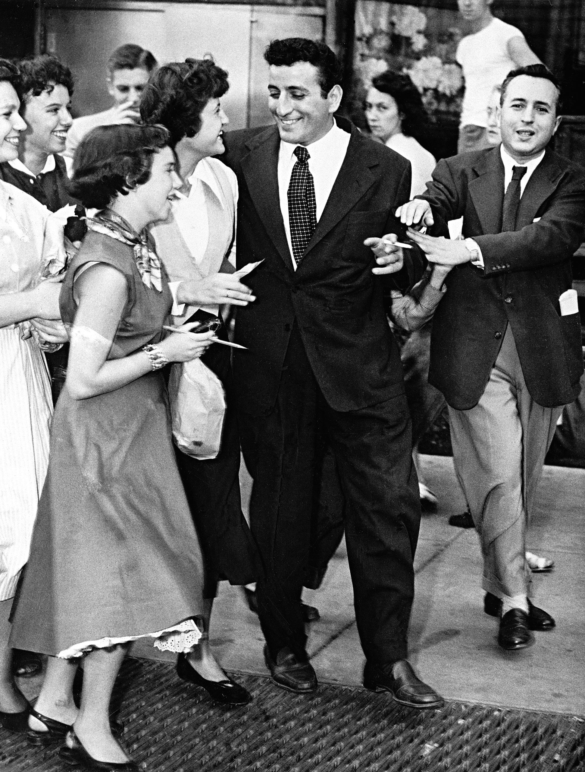 Tony Bennett approached by autograph seekers as he leaves a performance on Oct. 4, 1951.