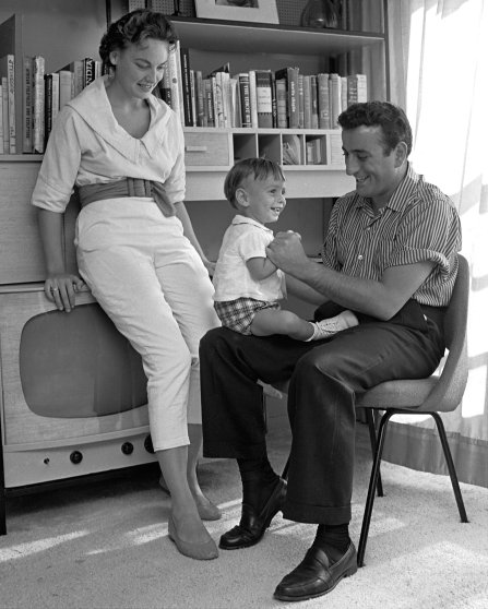 Singer Tony Bennett and his wife, Sandy, plays with their young son, D'Andrea in their apartment in the Riverdale section of the Bronx.