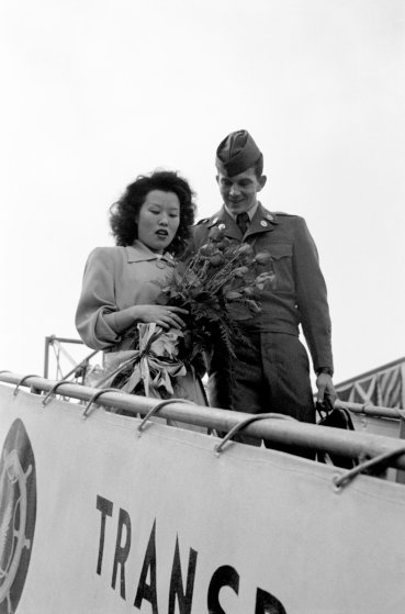 """Sgt. Johnie Morgan arrives in Seattle with his wife, """"Blue,"""" 1951."""
