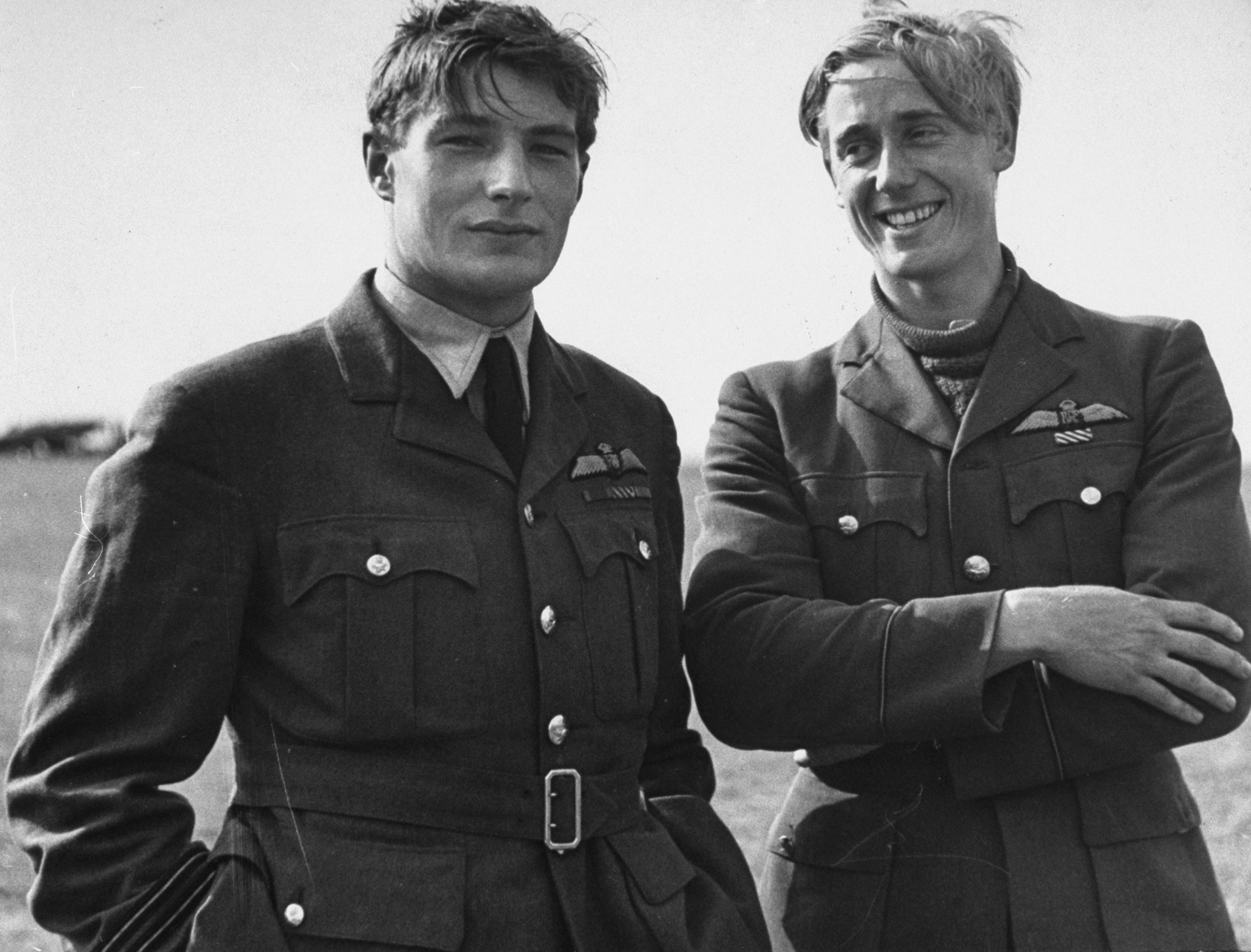 Two pilots (Flying Officer Albert Gerald Lewis on right, on right; a flyer who appears to be Richard Lee, unidentified in archival notes, at left, between flights during the Battle of Britain, RAF Fighter Command airfield, 1940.