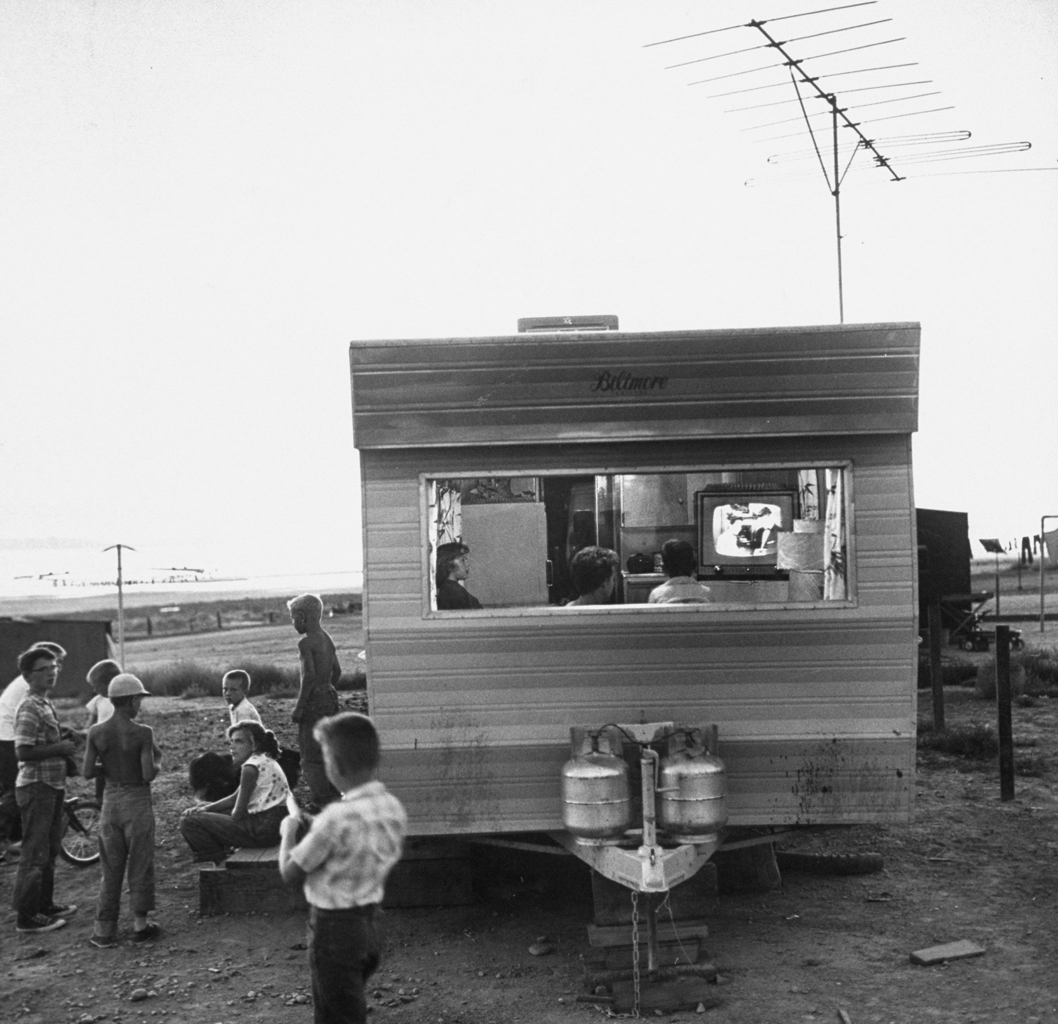 A railroad worker's family watches TV in a trailer at a camp for Southern Pacific employees in Utah in 1957.