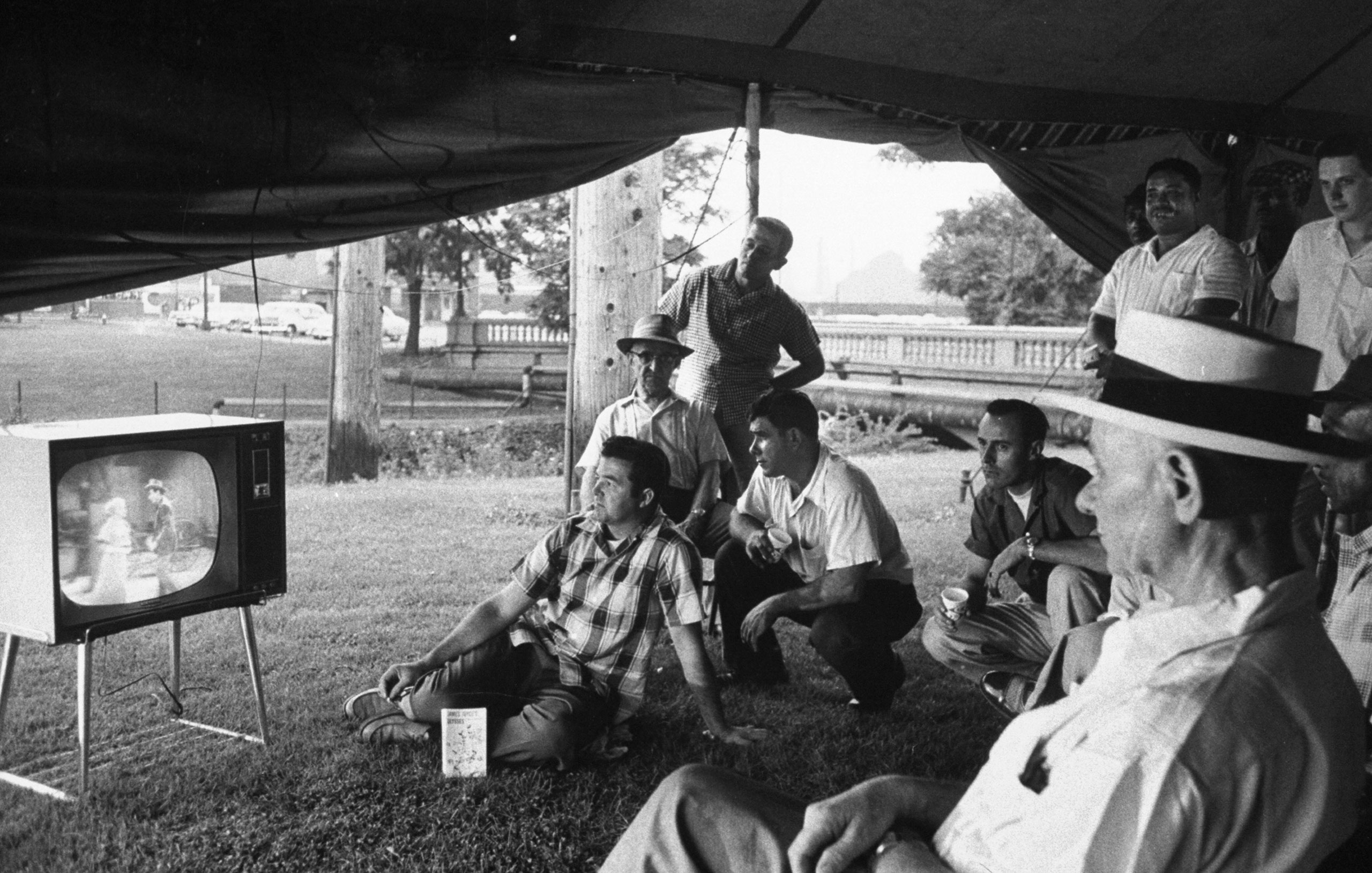 Picketing workers watch TV in a tent outside the gates of a U.S. Steel plant in Gary, Indiana, during a strike in 1959.