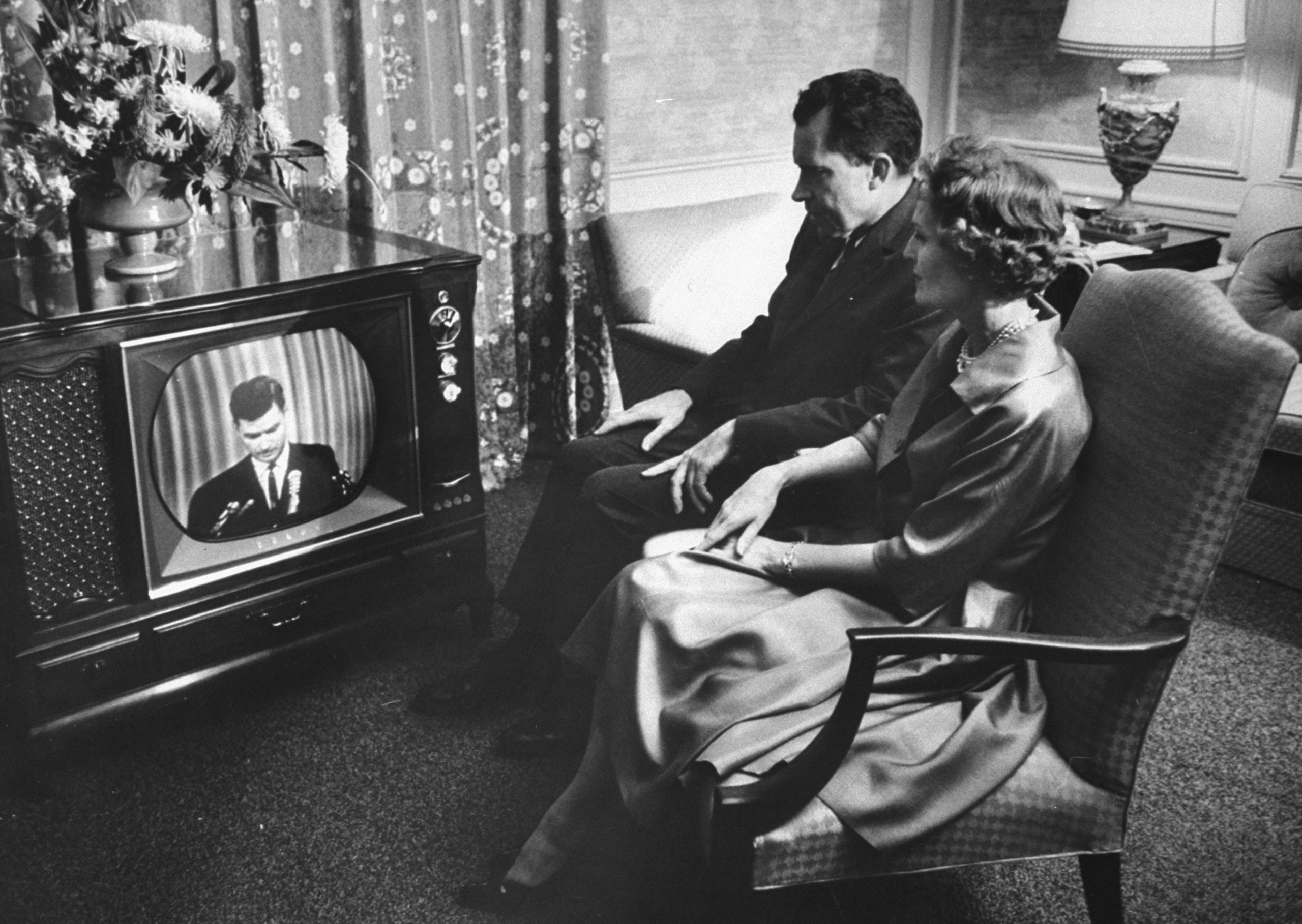 Vice President Richard Nixon and his wife, Pat, watch the 1960 GOP convention in Chicago from their hotel suite.