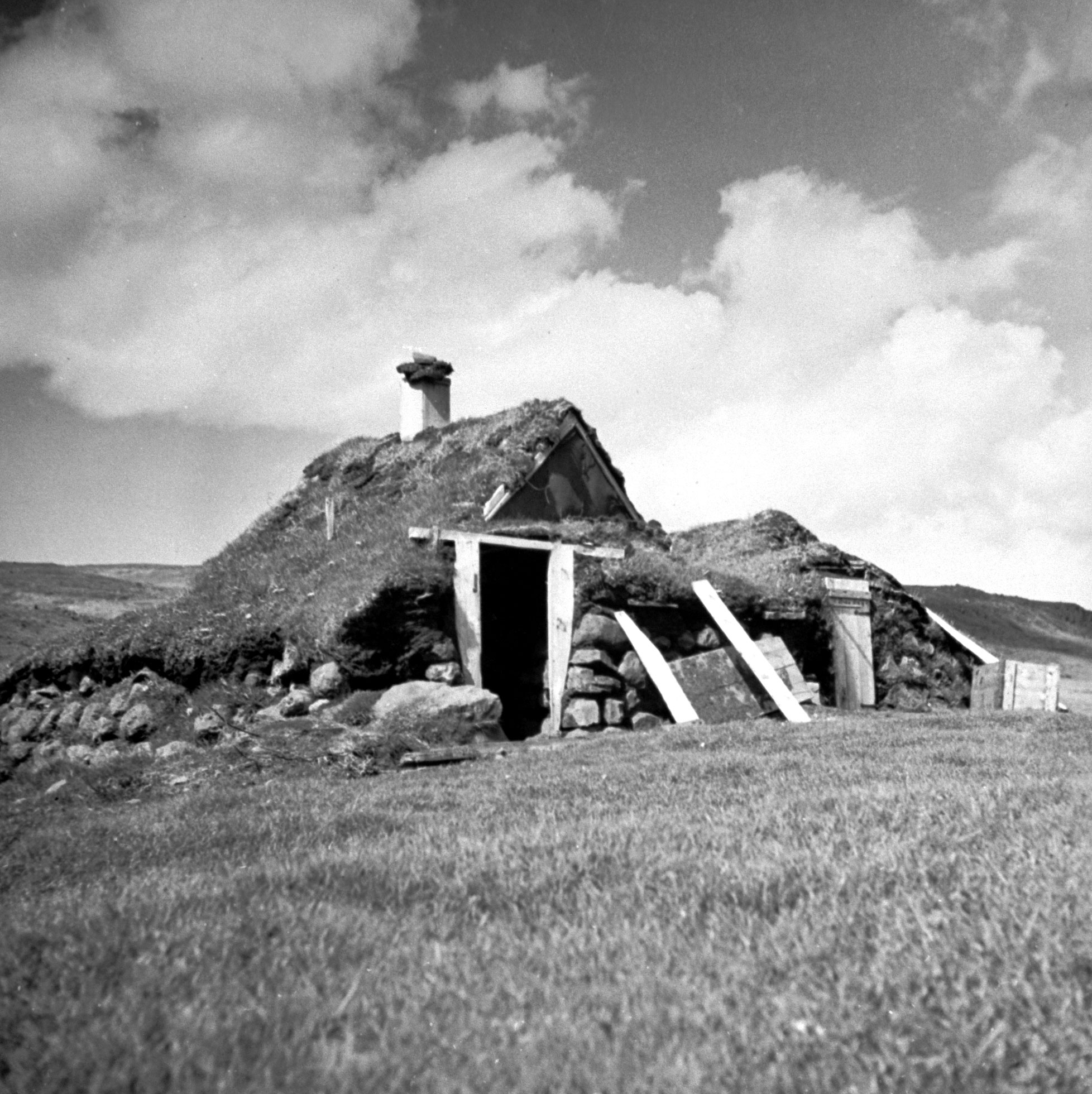 """<b>Caption from print:</b> """"Traveling is not always easy and comfortable in Iceland. When it has been raining for days, tents and night things are all drenched, you are very glad to find shelter in an old sheep-fold like this."""""""