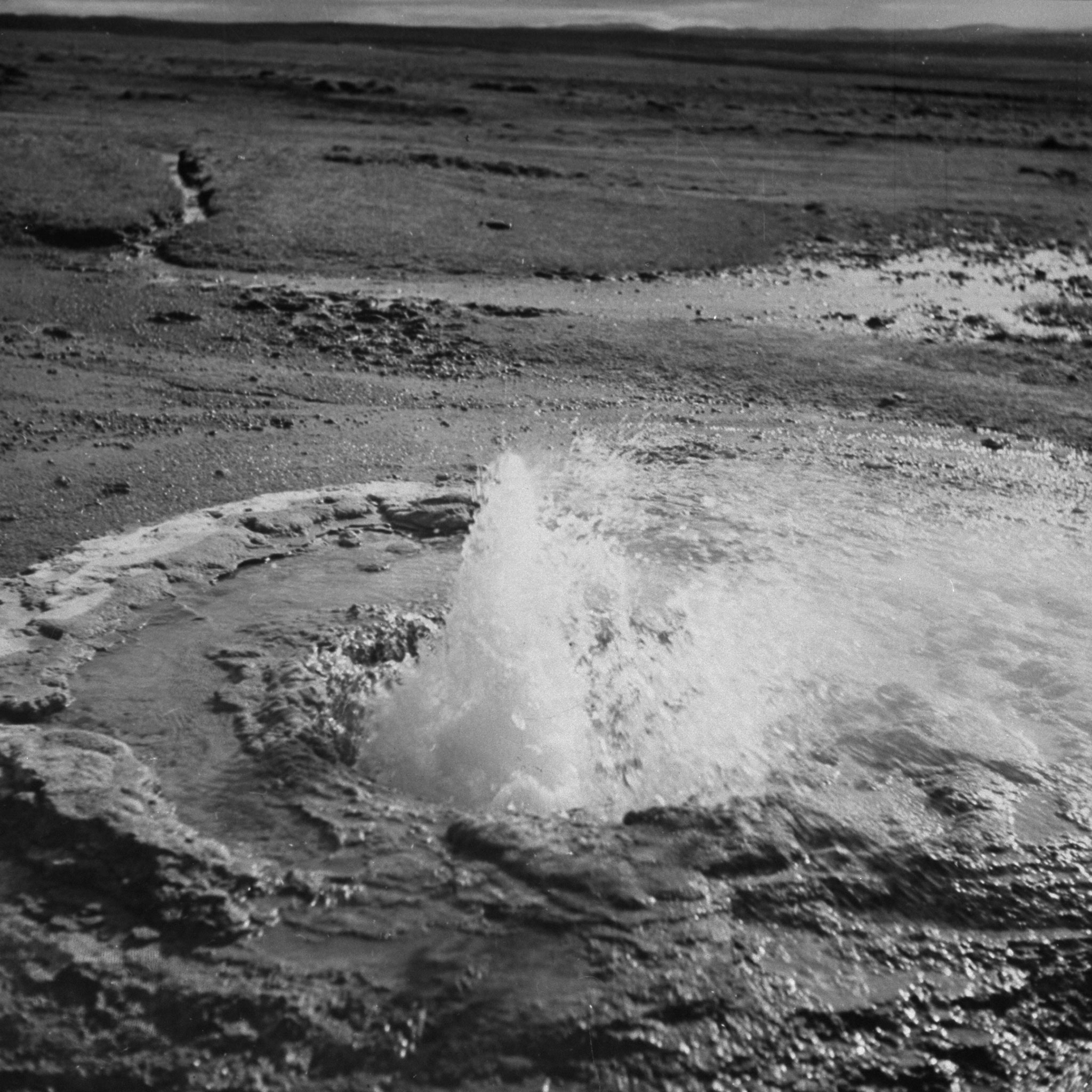 Water bubbling and boiling in a geyser.