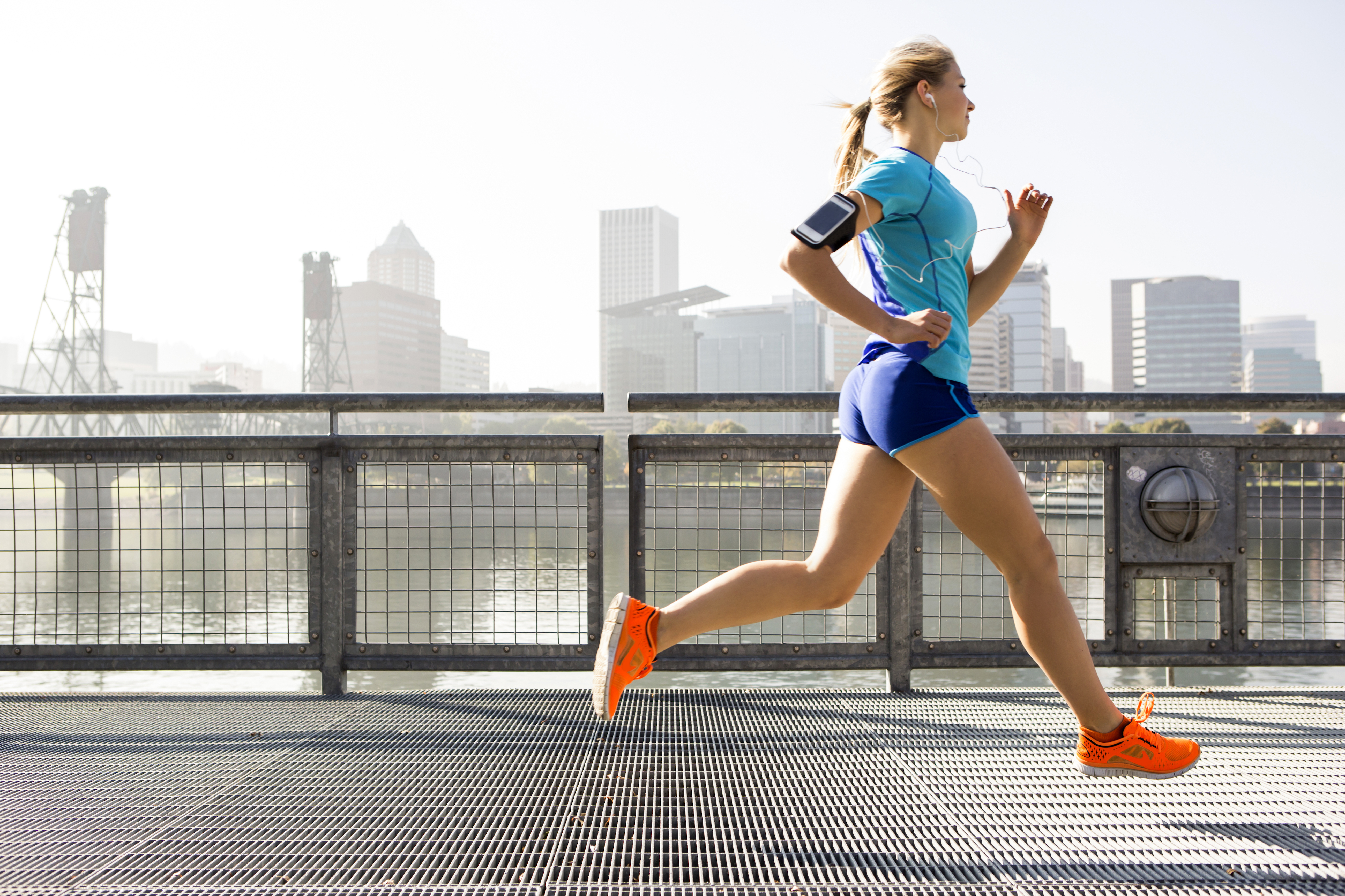 A young girl running for exercise.