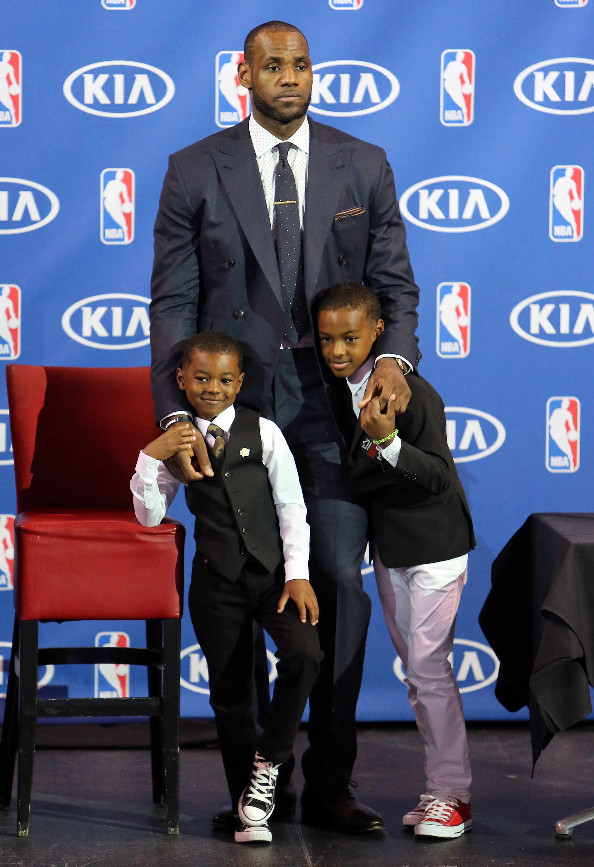 LeBron James, center, his sons Bryce James, left, and LeBron James Jr. attend a press conference to announce his Fourth NBA MVP Award in Miami on May 5, 2013