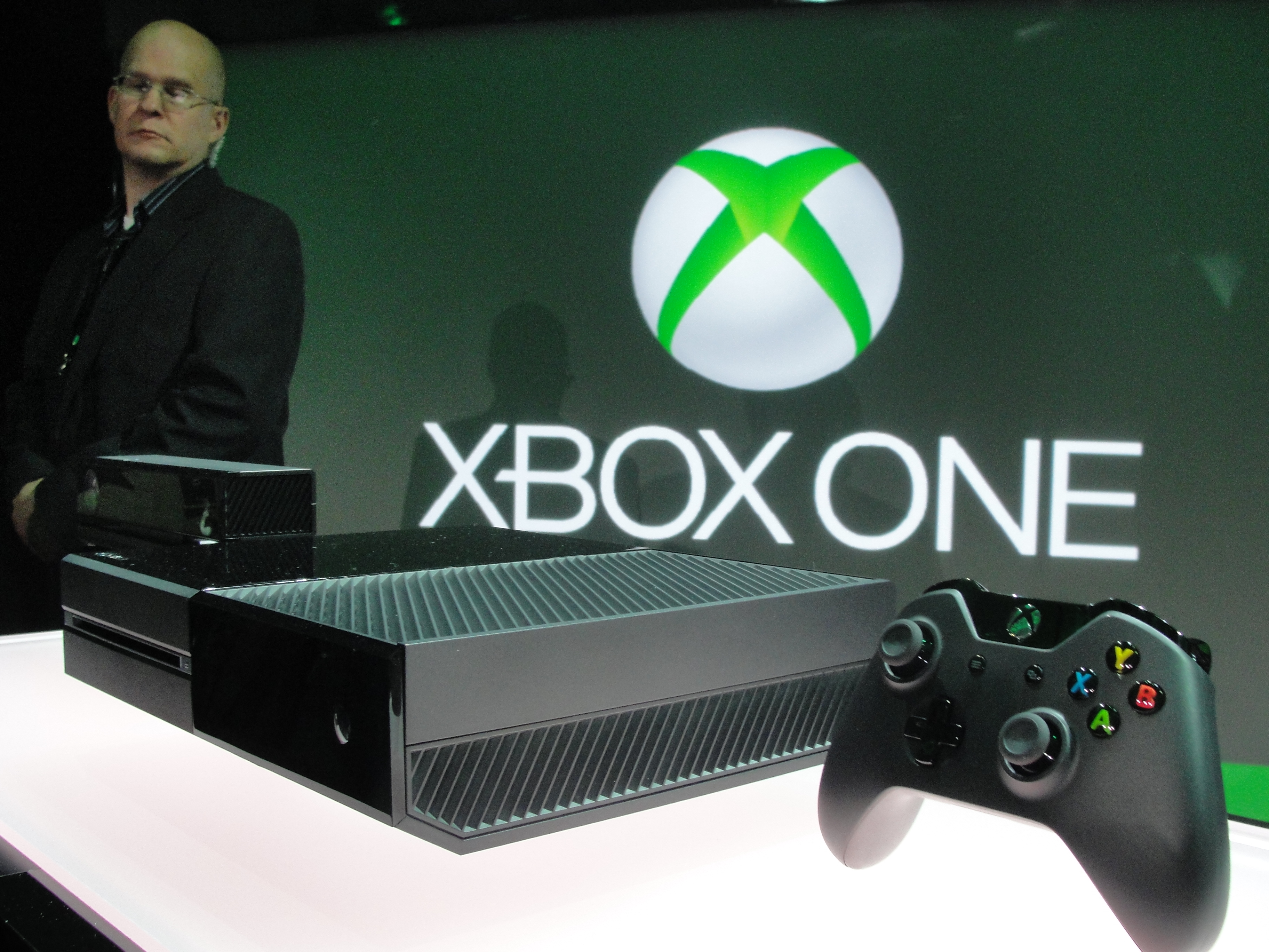 A member of the Microsoft security team watches over the newly unveiled Xbox One videogame console at the Microsoft campus in Redmond, Washington, on May 21, 2013.