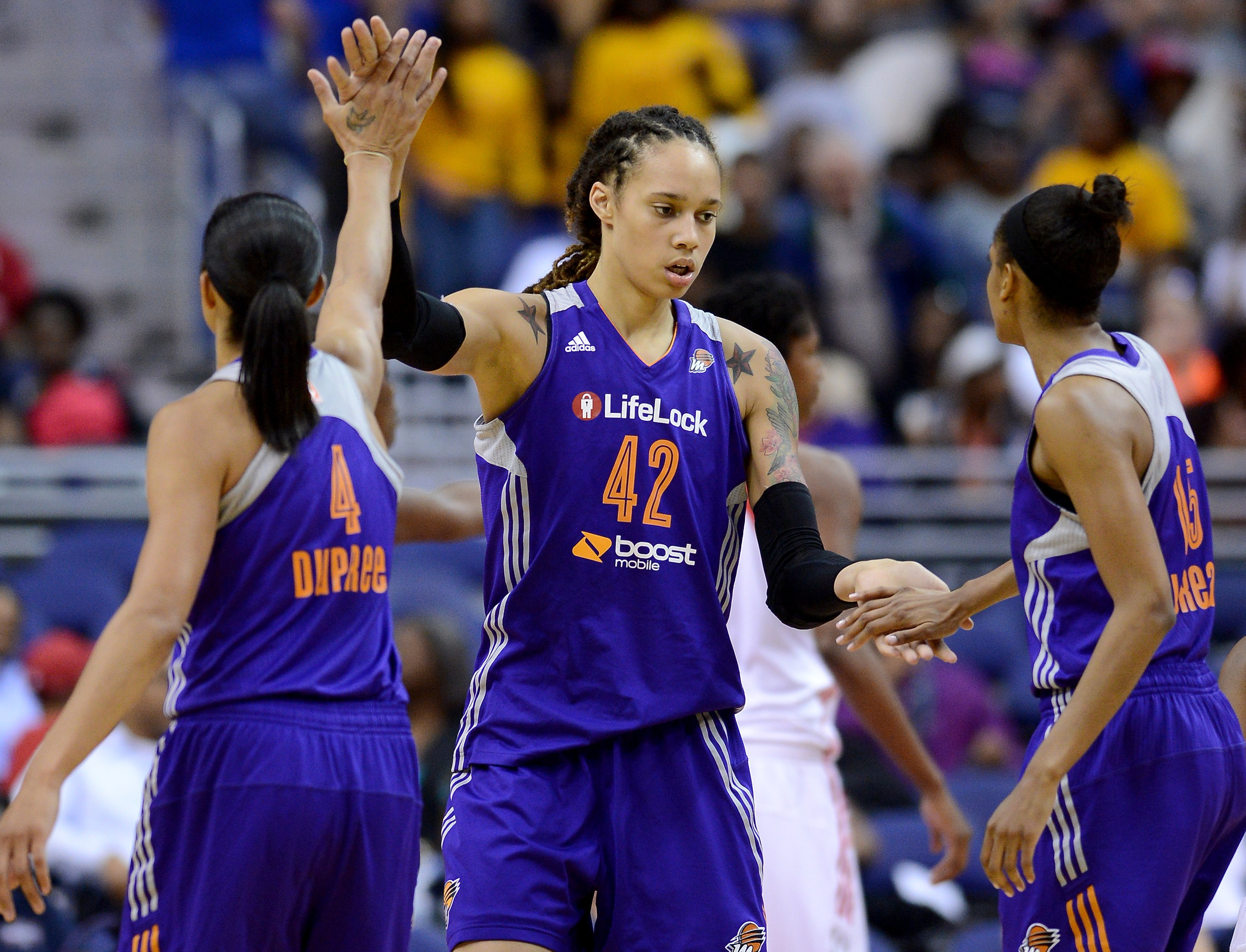 Phoenix Mercury Brittney Griner center (42) celebrates with teammates Candice Dupree (4) and Briana Gilbreath (15), after she scored and drew a foul against the Washington Mystics in the third quarter at the Verizon Center in Washington, D.C., Thursday, June 27, 2013,