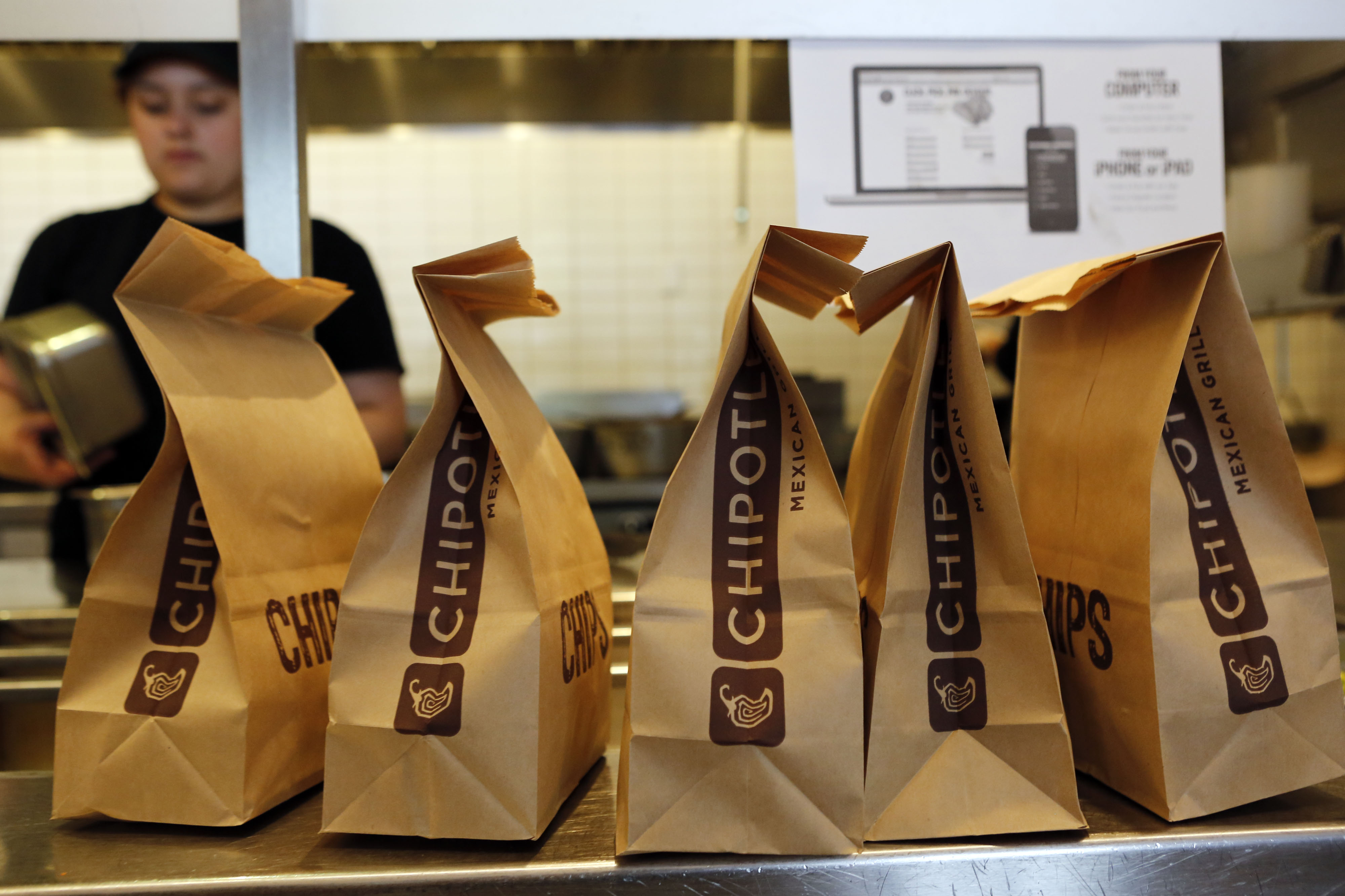Bags of tortilla chips sit in a row at a Chipotle Mexican Grill Inc. restaurant in Hollywood, California on July 16, 2013.