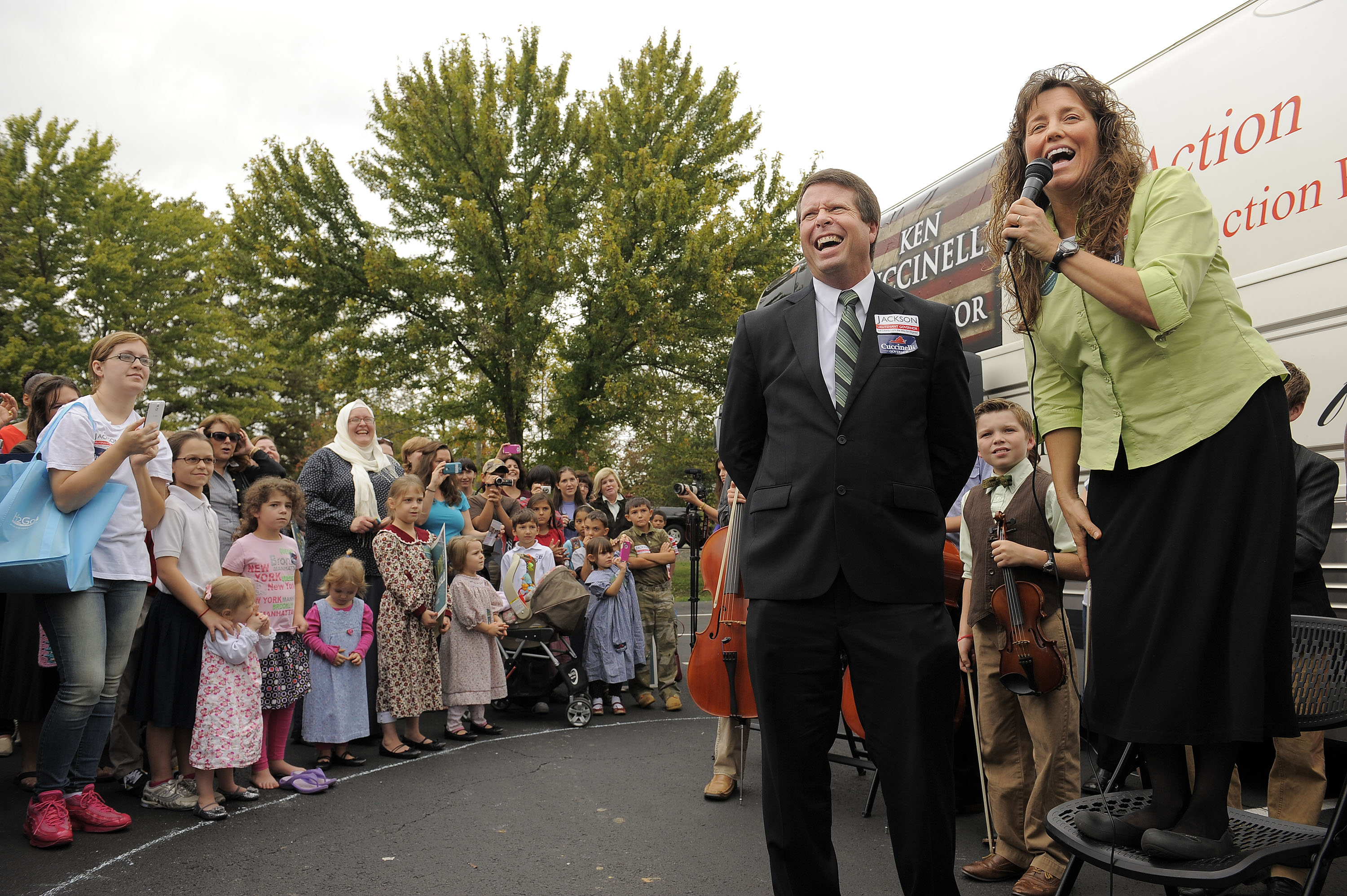 Reality telvision celebrities, Jim Bob Duggar, center, and his wife, Michelle Duggar make a stop on their  Values Bus Tour  outside Heritage Baptist Church on Wednesday October 16, 2013 in Woodbridge, VA.