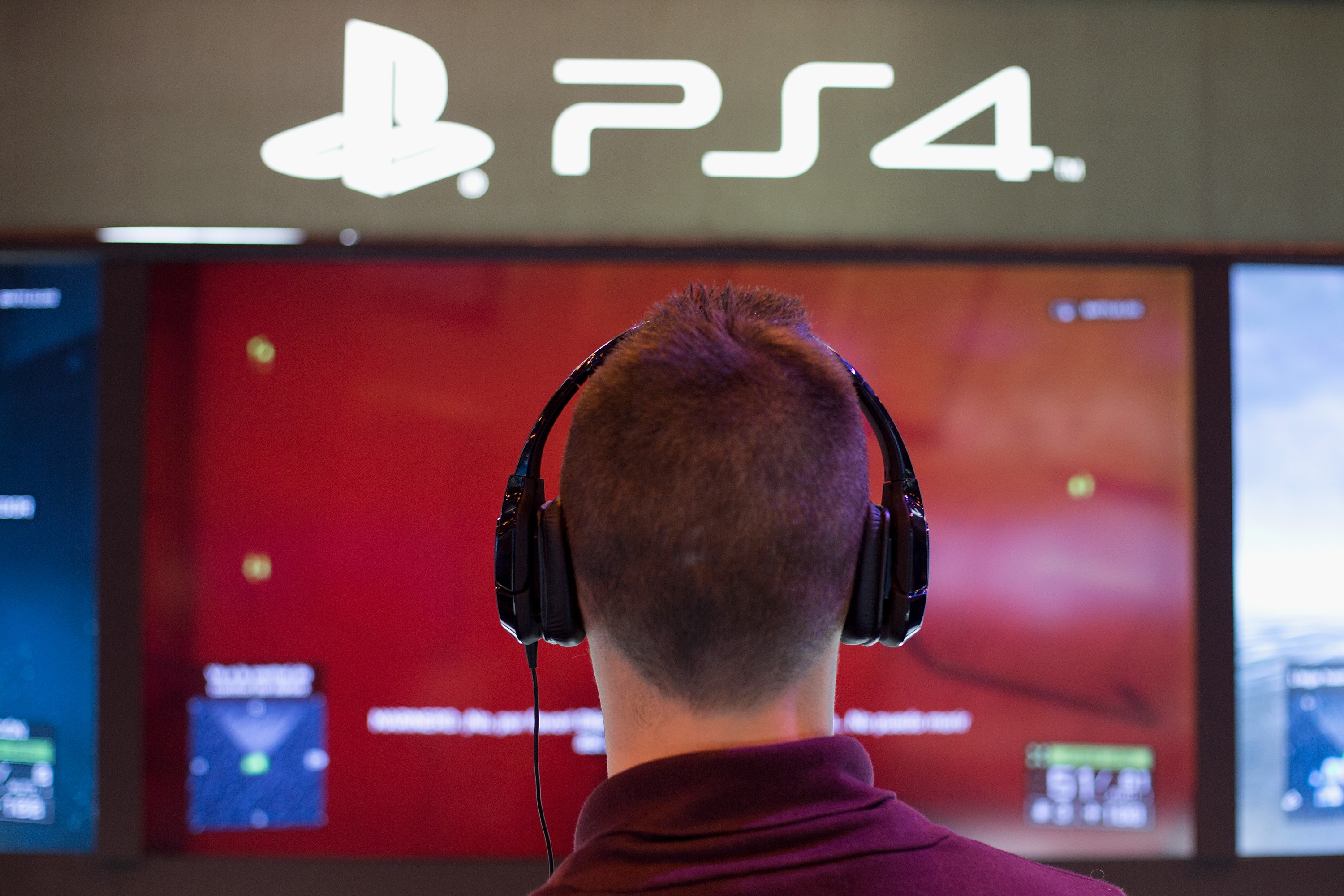 A man plays on a Playstation 4 at Madrid Games Week in IFEMA on November 9, 2013 in Madrid, Spain.