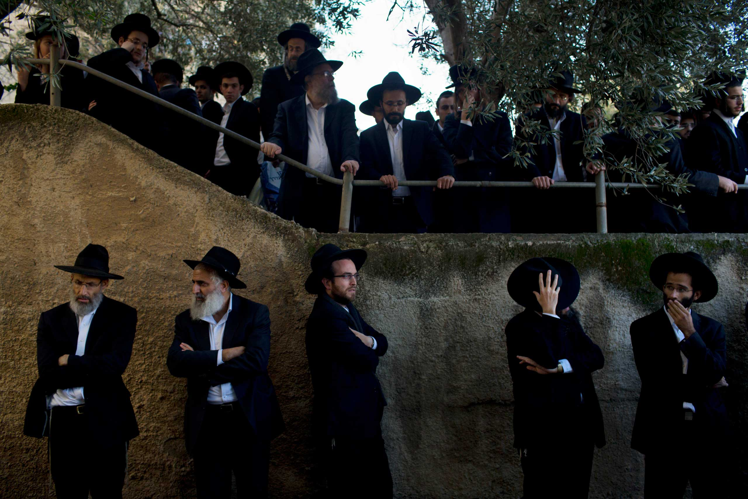 Nov. 18, 2014. Ultra-Orthodox Jews attend the funeral of Mosheh Twersky in Jerusalem. Two Palestinian cousins armed with meat cleavers and a gun stormed a Jerusalem synagogue during morning prayers, killing Twersky and three others in the city's bloodiest attack in years. Police killed the attackers in a shootout.