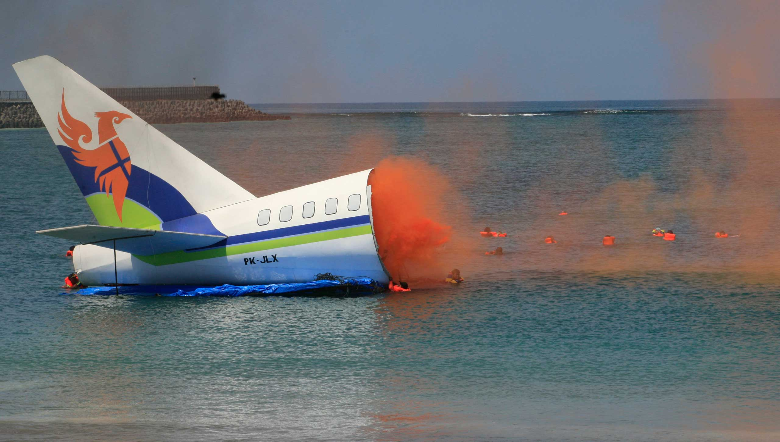 Nov. 18, 2014. Passengers flee from a mock plane fuselage, during a rescue exercise at Bali's International Ngurah Rai Airport in Indonesia.