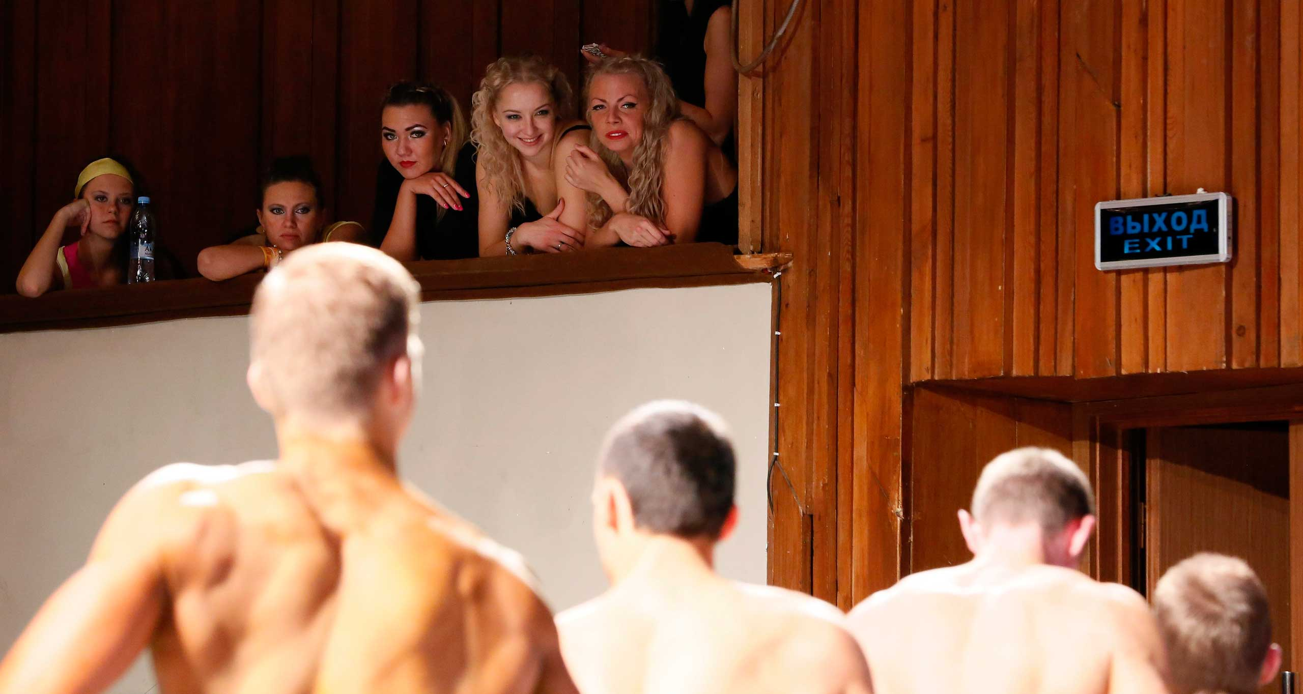 Nov. 1, 2014. Spectators look at the participants of the  Strong Body  category competition for beginners during the 5th  Strongo Cup  open amateur bodybuilding tournament at the State Opera and Ballet Theatre in Russia's Siberian city of Krasnoyarsk. Participants from all over Russia took part in the tournament competing in bodybuilding, body fitness and bikini fitness disciplines.
