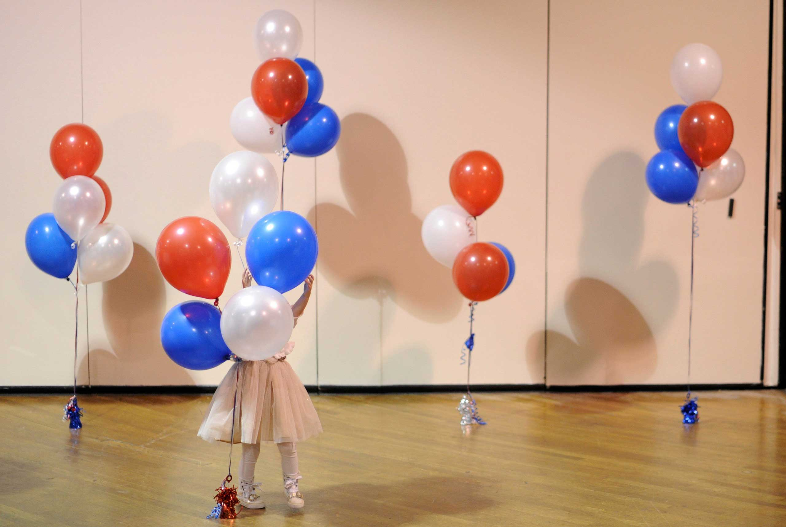 Nov. 4, 2014. A girl plays with balloons at Republican U.S. Senate candidate Scott Brown's midterm election night rally in Manchester, N.H.