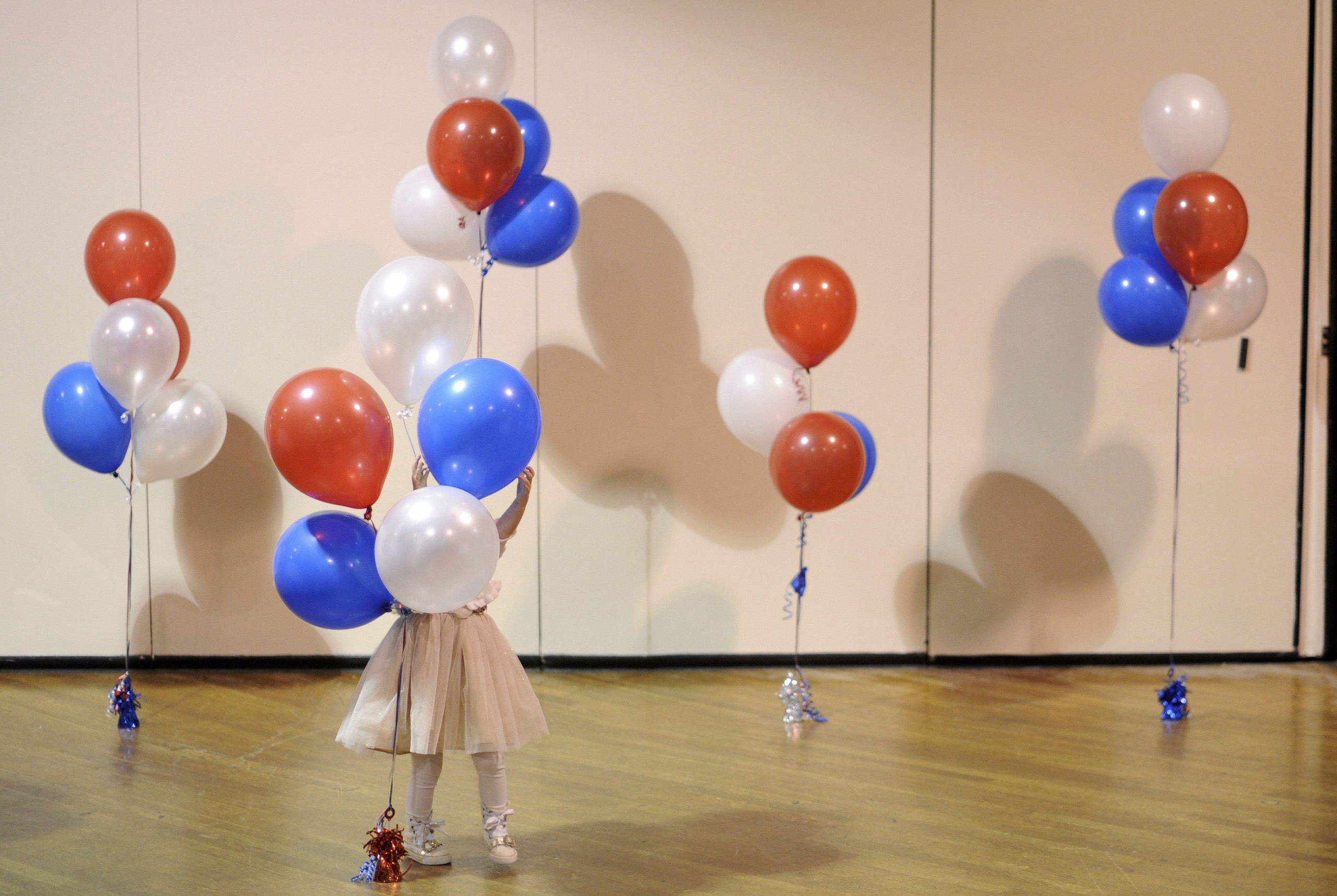 A little girl plays with balloons at Republican U.S. Senate candidate Scott Brown's midterm election night rally in Manchester, New Hampshire on Nov. 4, 2014.