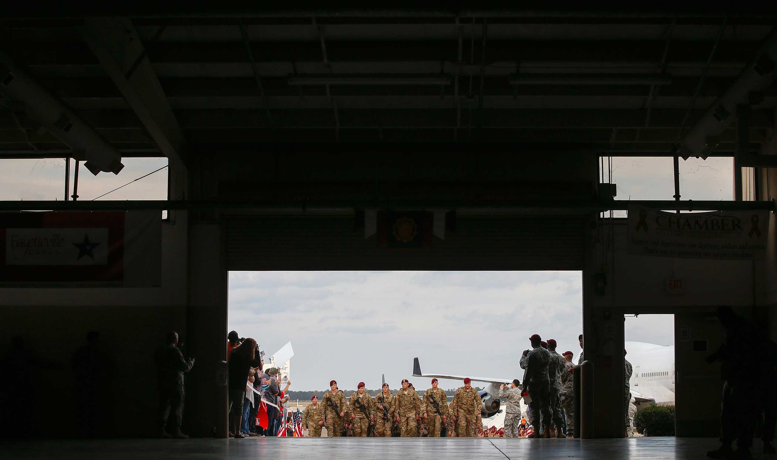 Nov. 5, 2014. Paratroopers with the First Brigade Combat Team, 82nd Airborne Division, march up the ramp as they return home from Afghanistan, at Pope Army Airfield in Fort Bragg, N.C. Approximately 300 troops arrived home after being deployed since February 2014.
