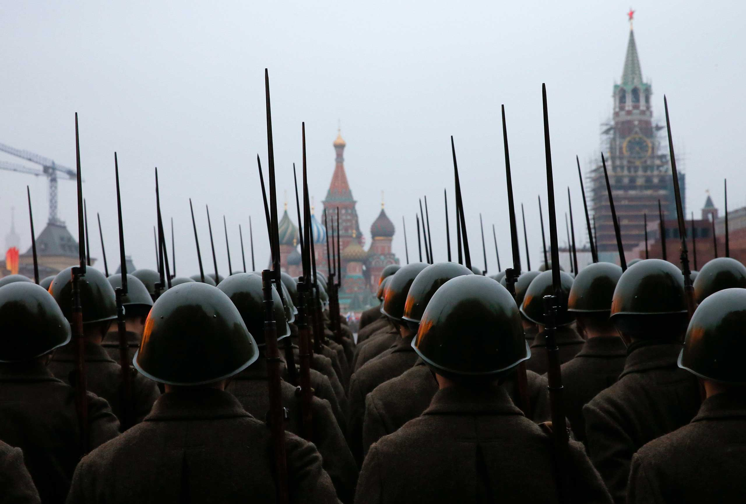 Nov. 5, 2014. Russian servicemen dressed in historical uniforms take part in a rehearsal for a military parade at the Red Square in Moscow.  The parade will be held on Nov. 7 to mark the anniversary of a historical parade in 1941, when Soviet soldiers marched through the Red Square towards the front lines of World War II.