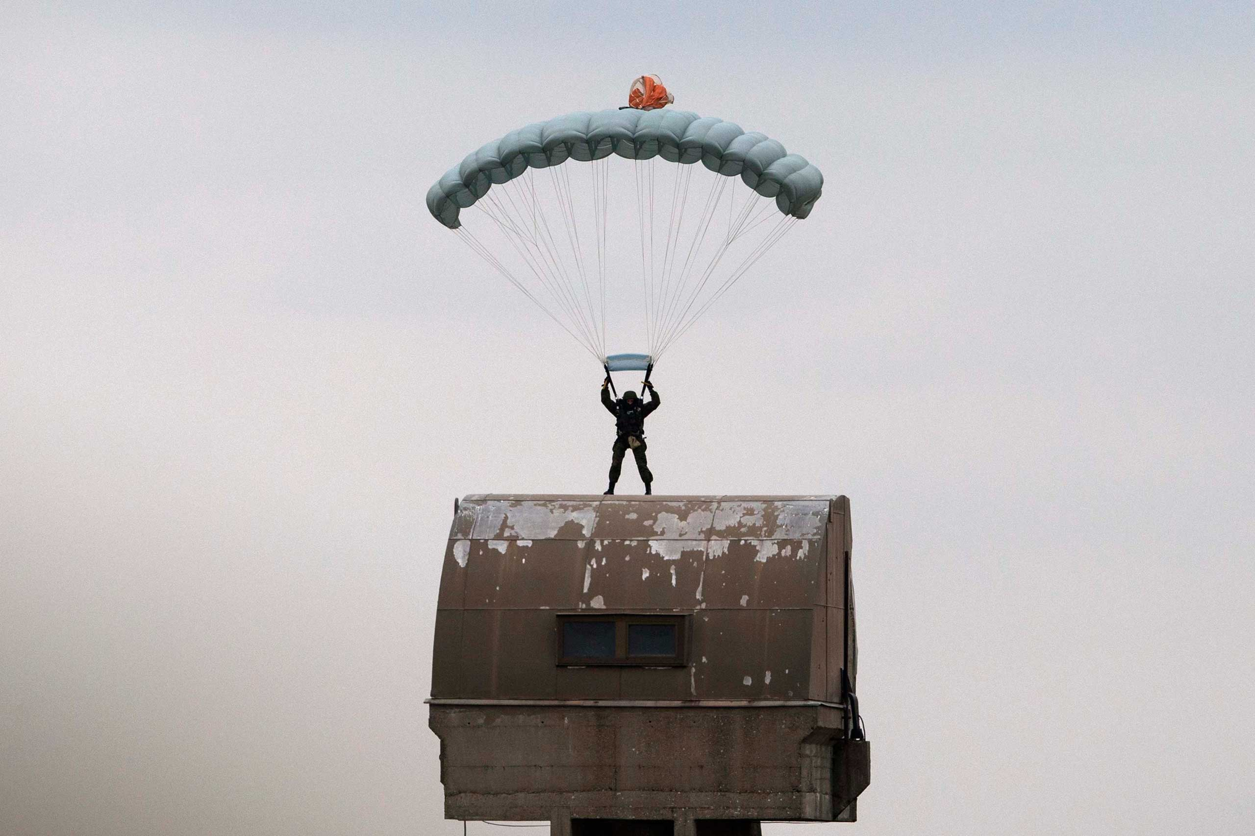 Nov. 14, 2014. A Russian paratrooper descends to the ground during a training exercise in the village of Nikinci, west from Belgrade, Serbia. Russian soldiers parachuted into open fields in western Serbia as part of an unprecedented joint military drill that has stirred controversy.