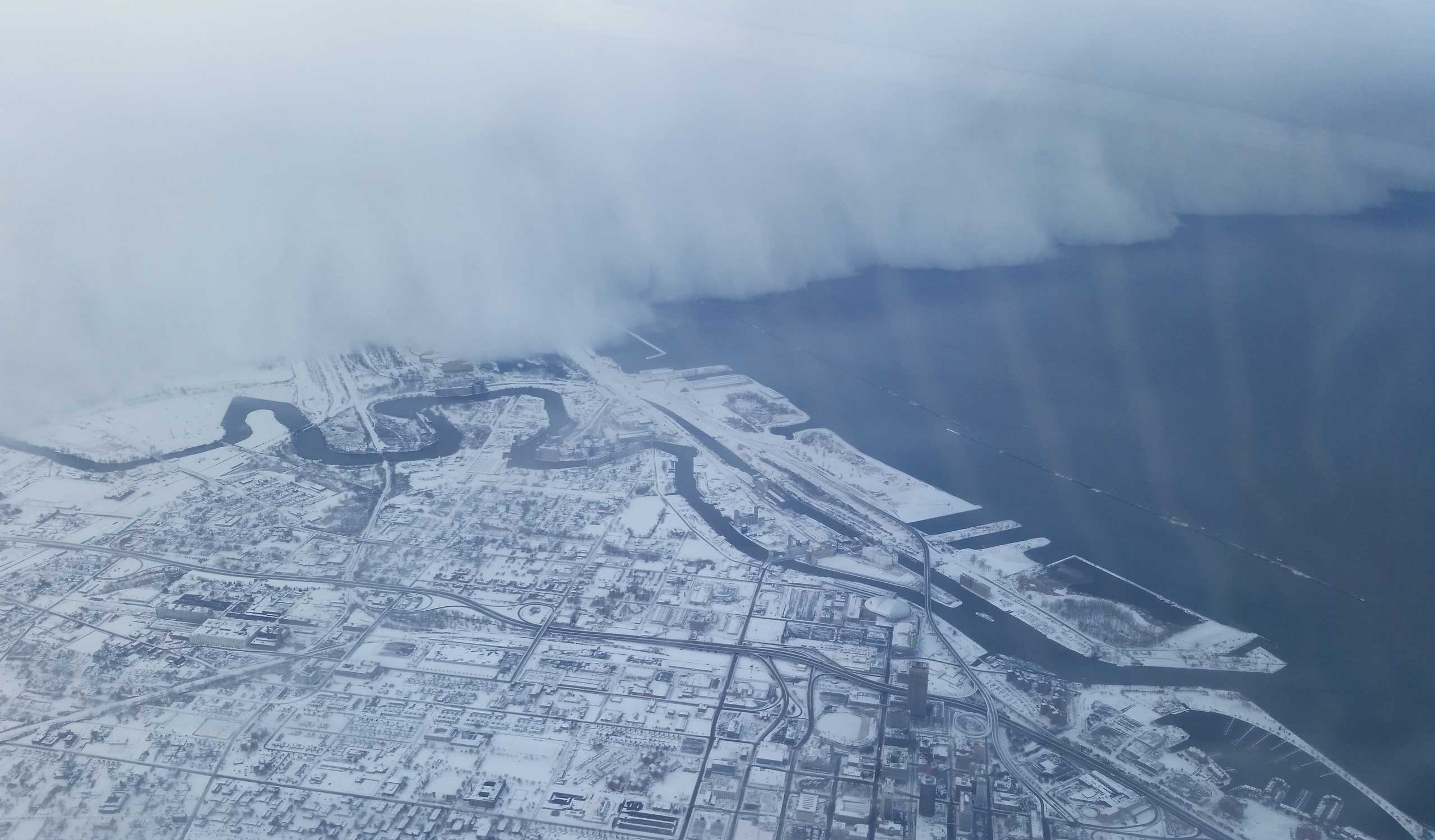 Nov. 18, 2014. This picture was taken by Jeffrey Suhr on his way from Buffalo, N.Y. to Minneapolis and was posted on his Twitter.                                   I live 3 miles from the airport, and I was surprised how much snow was at my house and how little was at the airport. So when I saw the well-defined snow band after take off, I thought I would take a photo,  Suhr tells TIME.