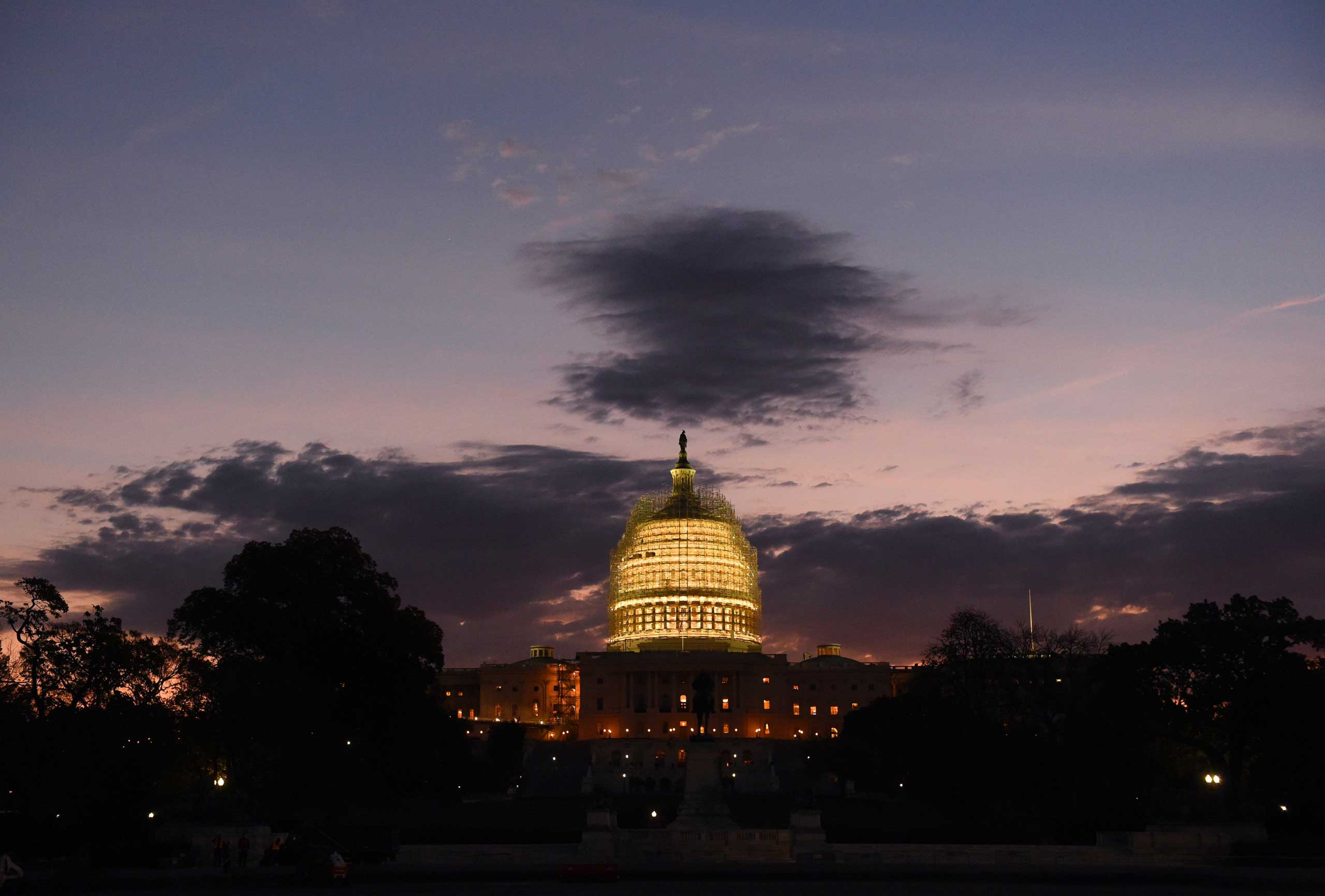 Nov. 4, 2014. The U.S. Capitol is lit up at dawn in Washington DC., while voters across the country are deciding who will occupy 36 governors' mansions and 36 Senate seats, with control of Congress hanging in the balance.