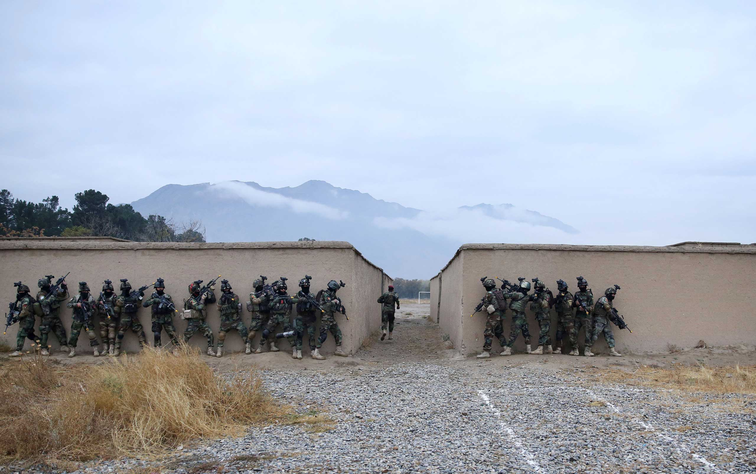 Nov. 6, 2014. Afghan special forces demonstrate their skills during Secretary General of NATO Jens Stoltenberg's first visit as the head of NATO at the special forces training camp in Kabul.